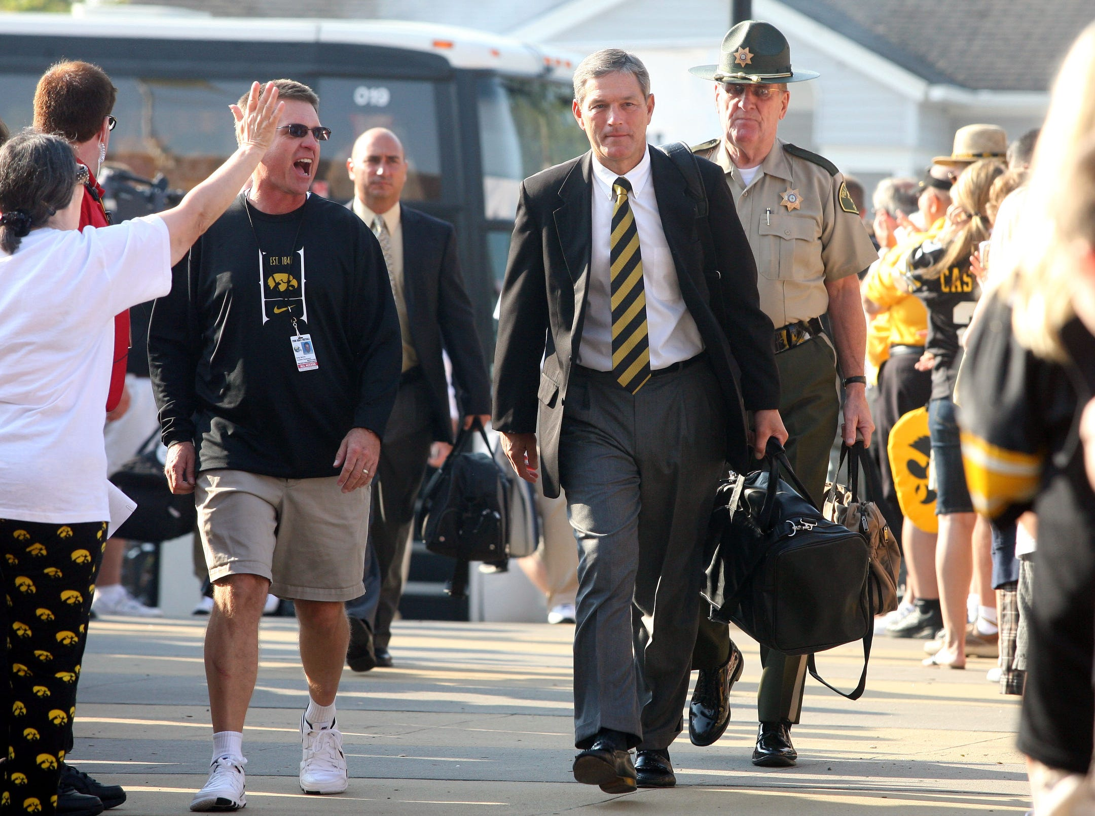Iowa head coach Kirk Ferentz arrives to fans' cheers before Iowa's football season opener Sept. 5, 2009 against Northern Iowa at Kinnick Stadium.
