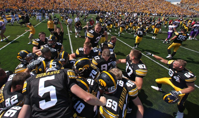 Iowa Hawkeyes celebrate their 17-16 win after blocking two back to back kick attempts by UNI's Billy Hallgren in the last seconds of the game Sept. 5, 2009.