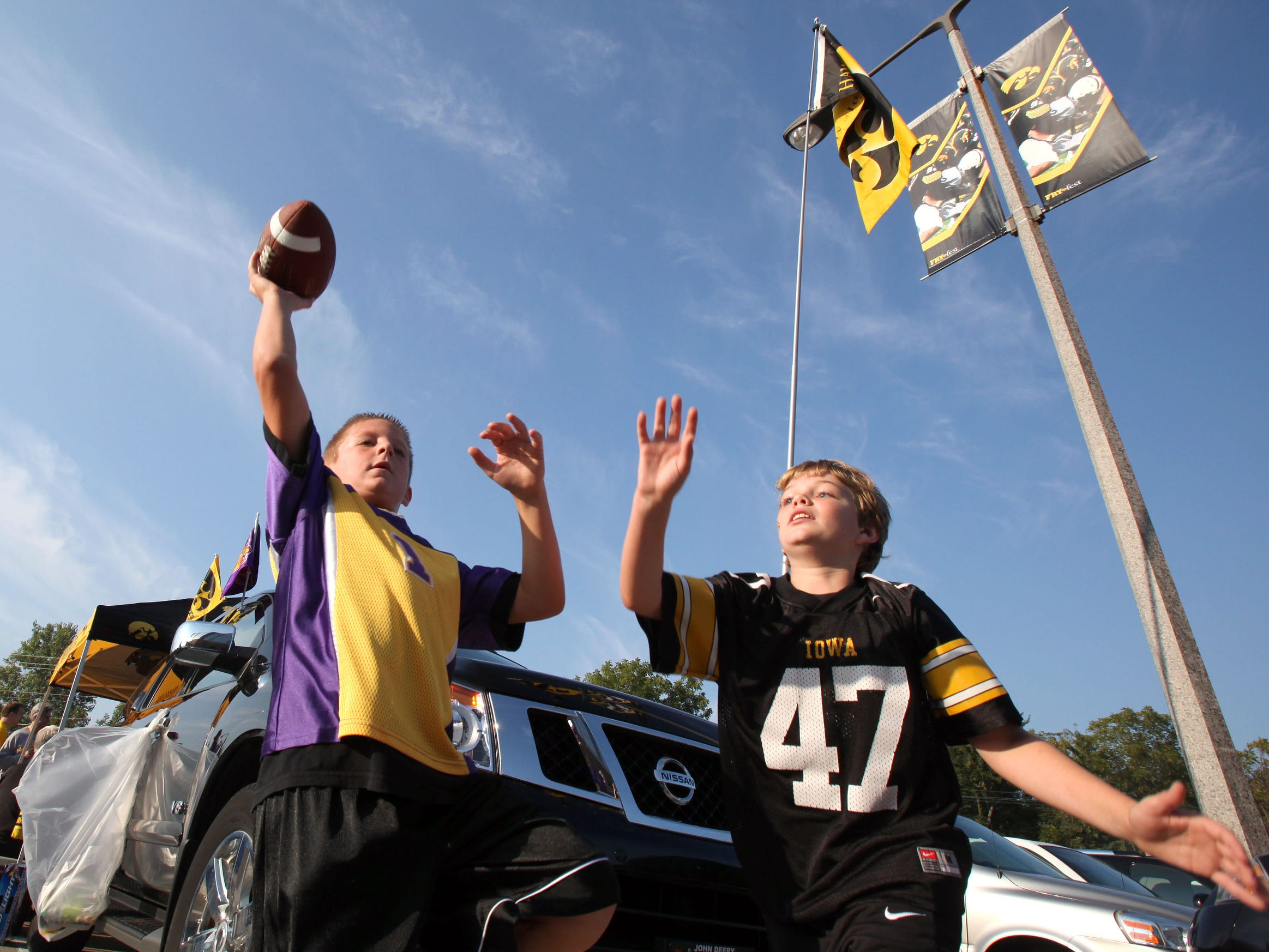 Panthers fan Brock Studer, left, 9, and Hawkeyes fan Alex Scanlon, 10, both of Johnston,  play a pick up game of football before Iowa's football season opener against Northern Iowa on Sept. 5, 2009 in Iowa City.