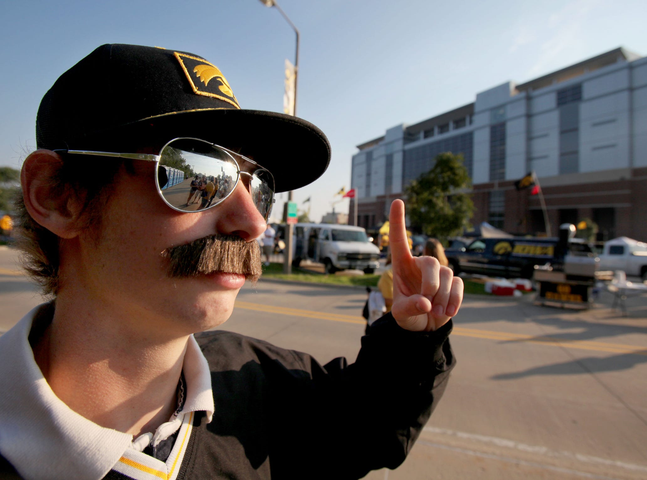 Hayden Fry impersonator Matt Travis of Iowa City greets Hawkeyes fans before Iowa's football season opener against Northern Iowa on Sept. 5, 2009 in Iowa City.
