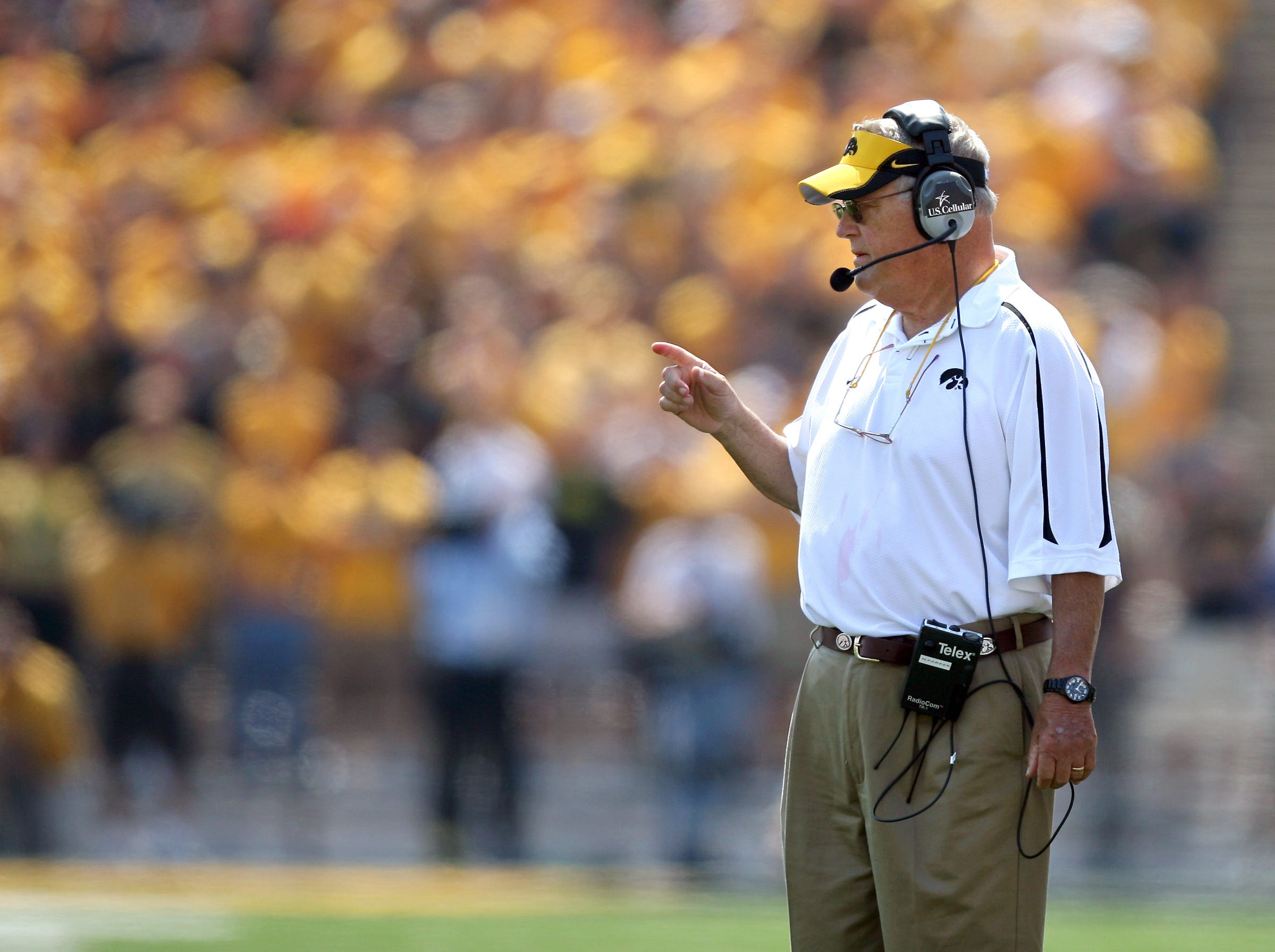 Iowa defensive coordinator Norm Parker signals his defense Sept. 5, 2009 against Northern Iowa in Iowa City.