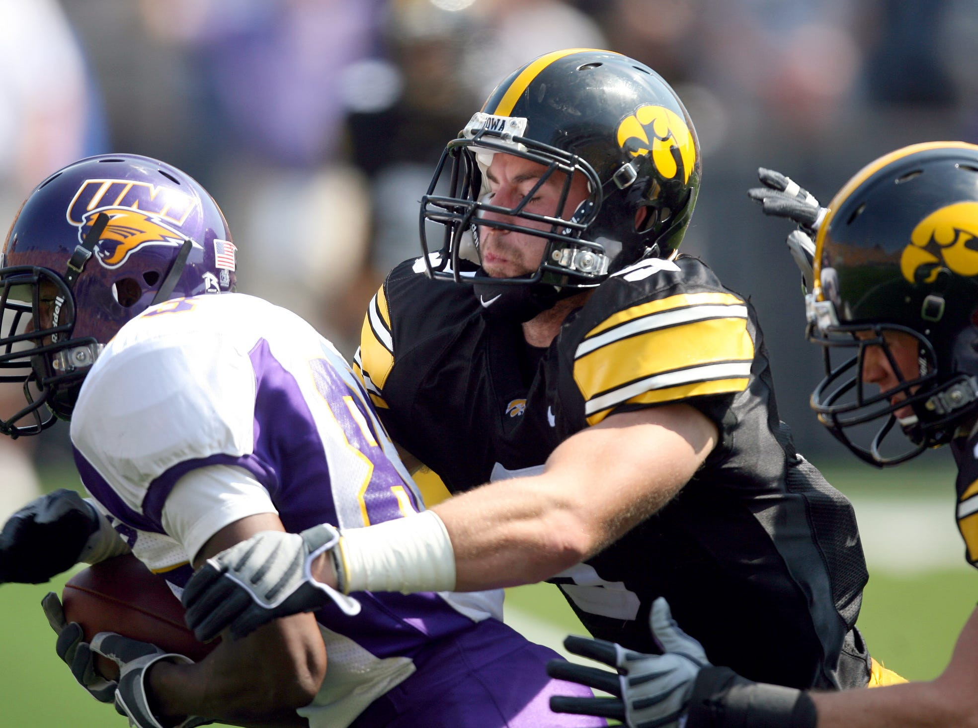 Iowa defensive backs Tyler Sash (9) and Brett Greenwood (30) tackle Northern Iowa wide receiver Jarred Herring after Herring pulled in a pass Sept. 5, 2009 in Iowa City.