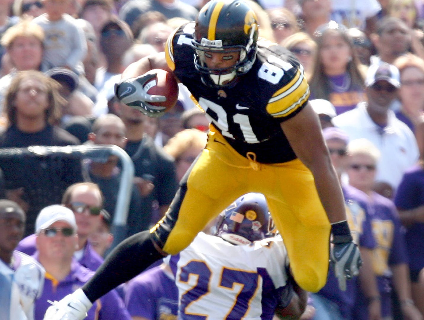 Iowa tight end Tony Moeaki (81) hurdles Northern Iowa cornerback Terrell McBride (27) after making a catch Sept. 5, 2009 in Iowa City.