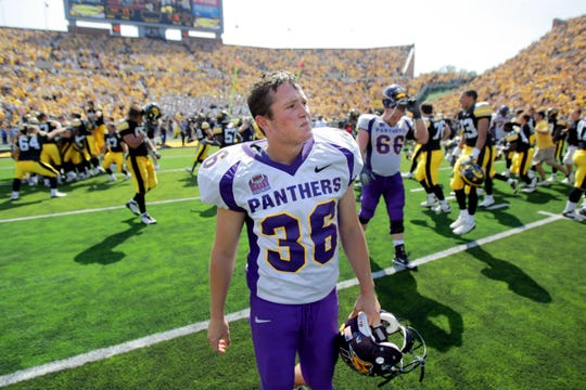 Northern Iowa kicker Billy Hallgren (36) walks off the field after two of his field goal attempts were blocked in succession to end the game Sept. 5, 2009 in Iowa City.  Iowa won, 17-16.