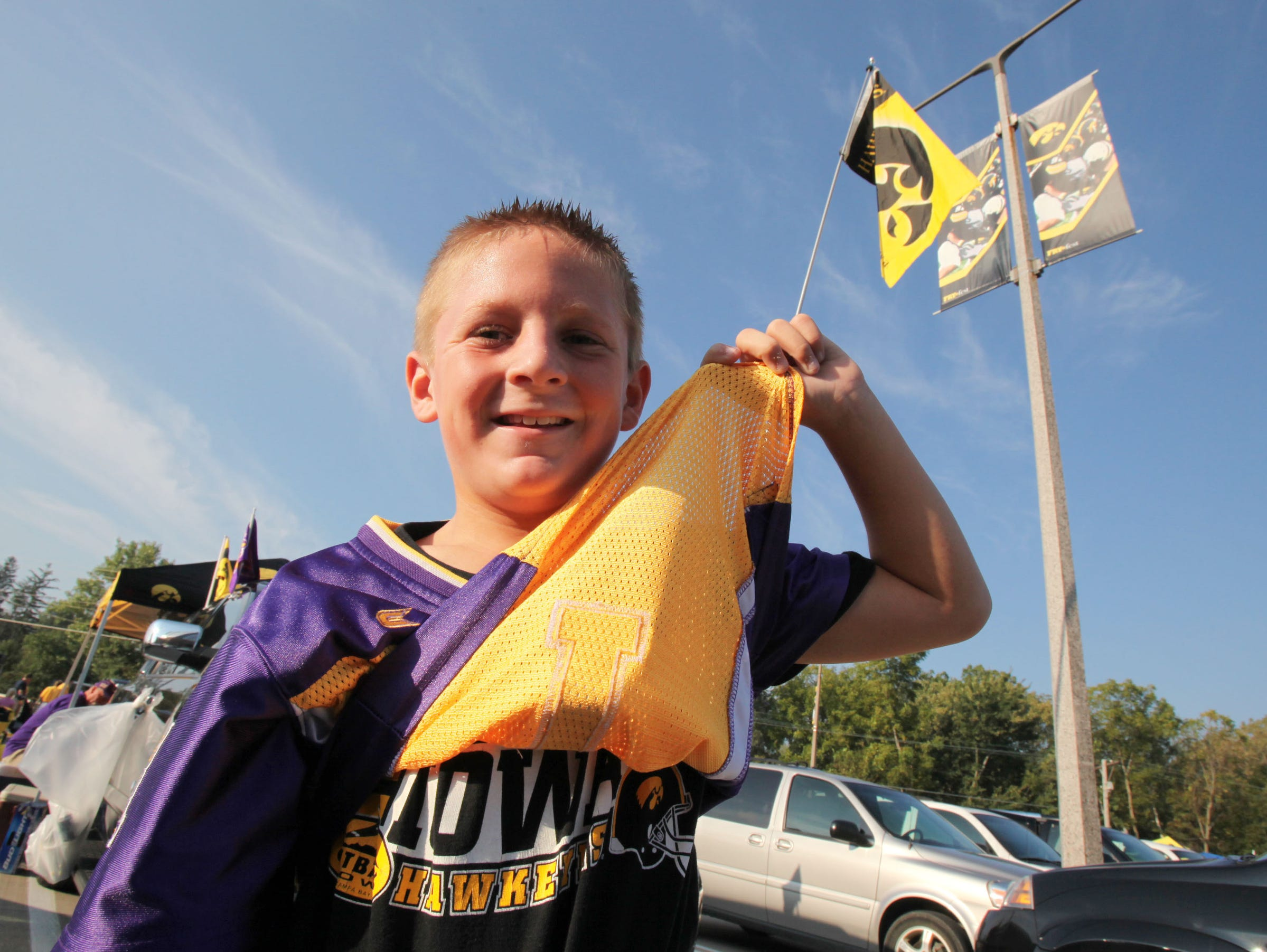 Brock Studer, 9, of Johnston shows off both Panther and Hawkeye colors before Iowa's football season opener against Northern Iowa on Sept. 5, 2009 in Iowa City.