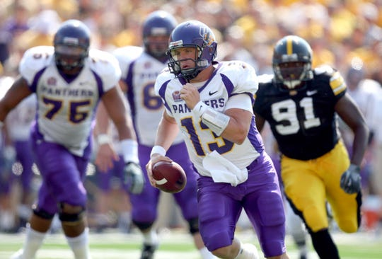 s0906iowafb - shot 09/04/09 Iowa City, IA.  Christopher Gannon/The Register  -- Iowa vs. Northern Iowa --   Northern Iowa quarterback Pat Grace (13) runs for a gain against Iowa Saturday in Iowa City.  (Christopher Gannon/The Des Moines Register)