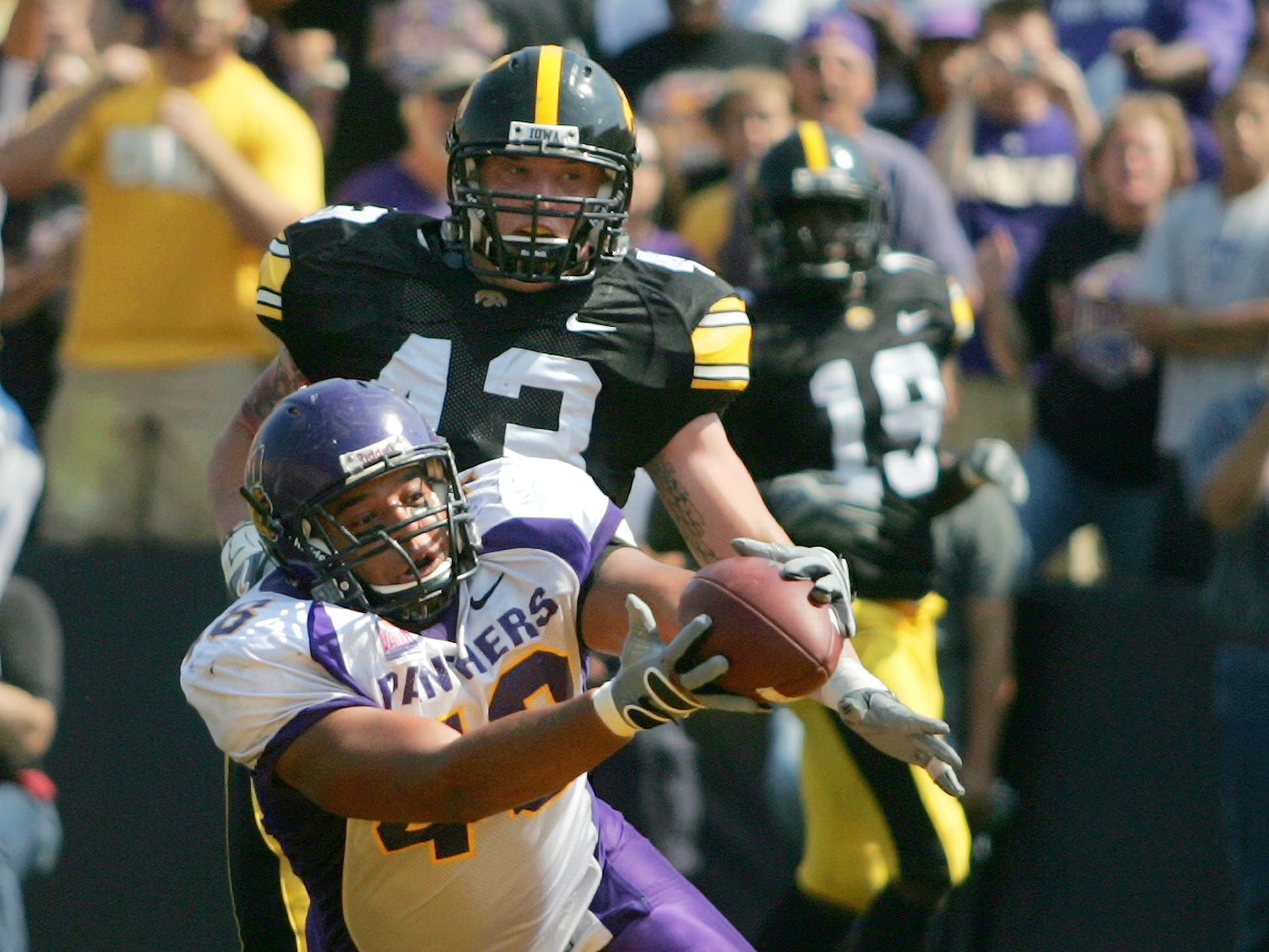 Northern Iowa tight end Ryan Mahaffey (48) catches a second quarter touchdown in front of Iowa linebacker Pat Angerer (43) to take a 10-3 lead Sept. 5, 2009 in Iowa City.