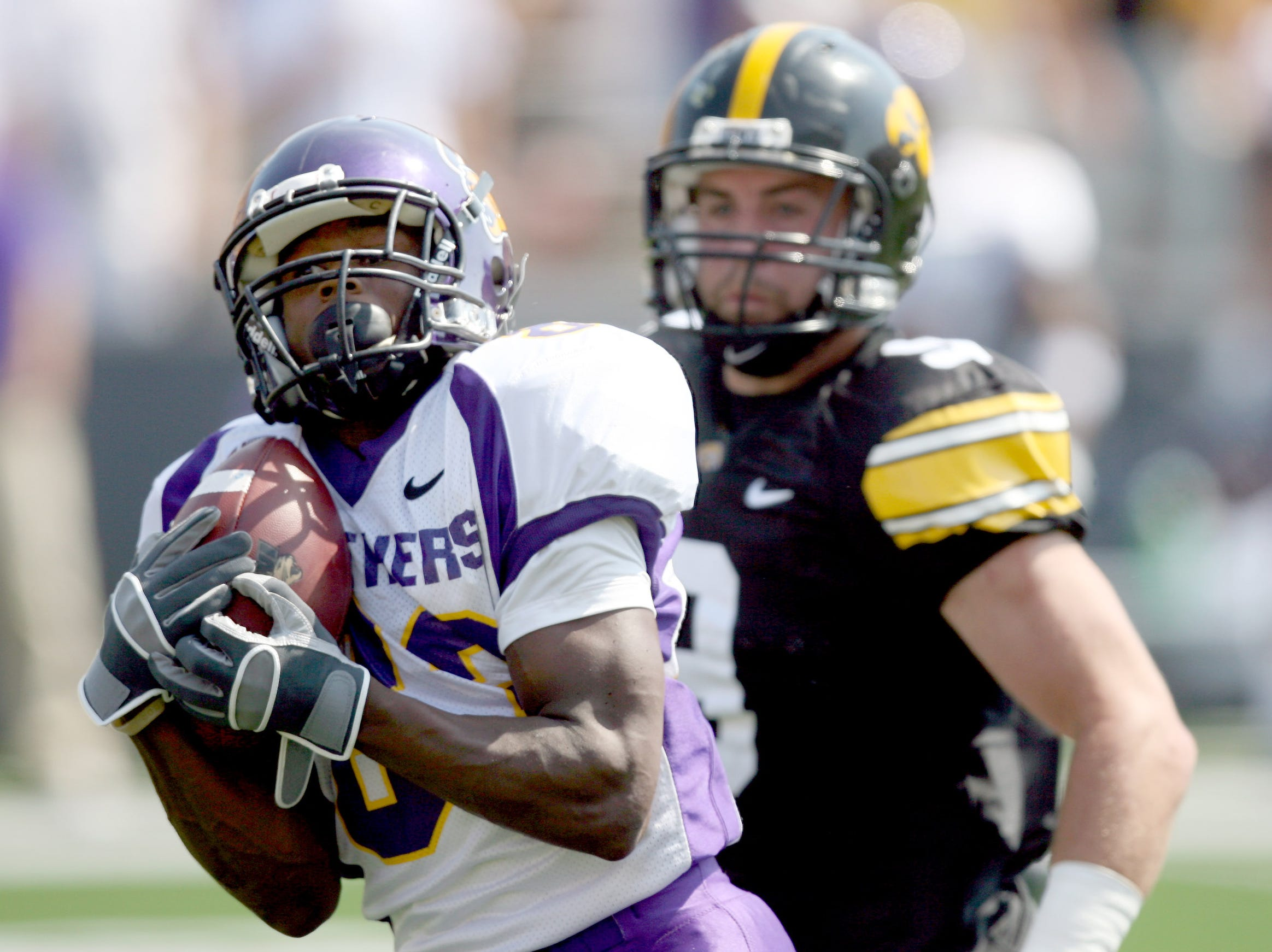 Northern Iowa wide receiver Jarred Herring hauls in a pass in front of Iowa cornerback Tyler Sash  in Iowa City on Sept. 5, 2009.