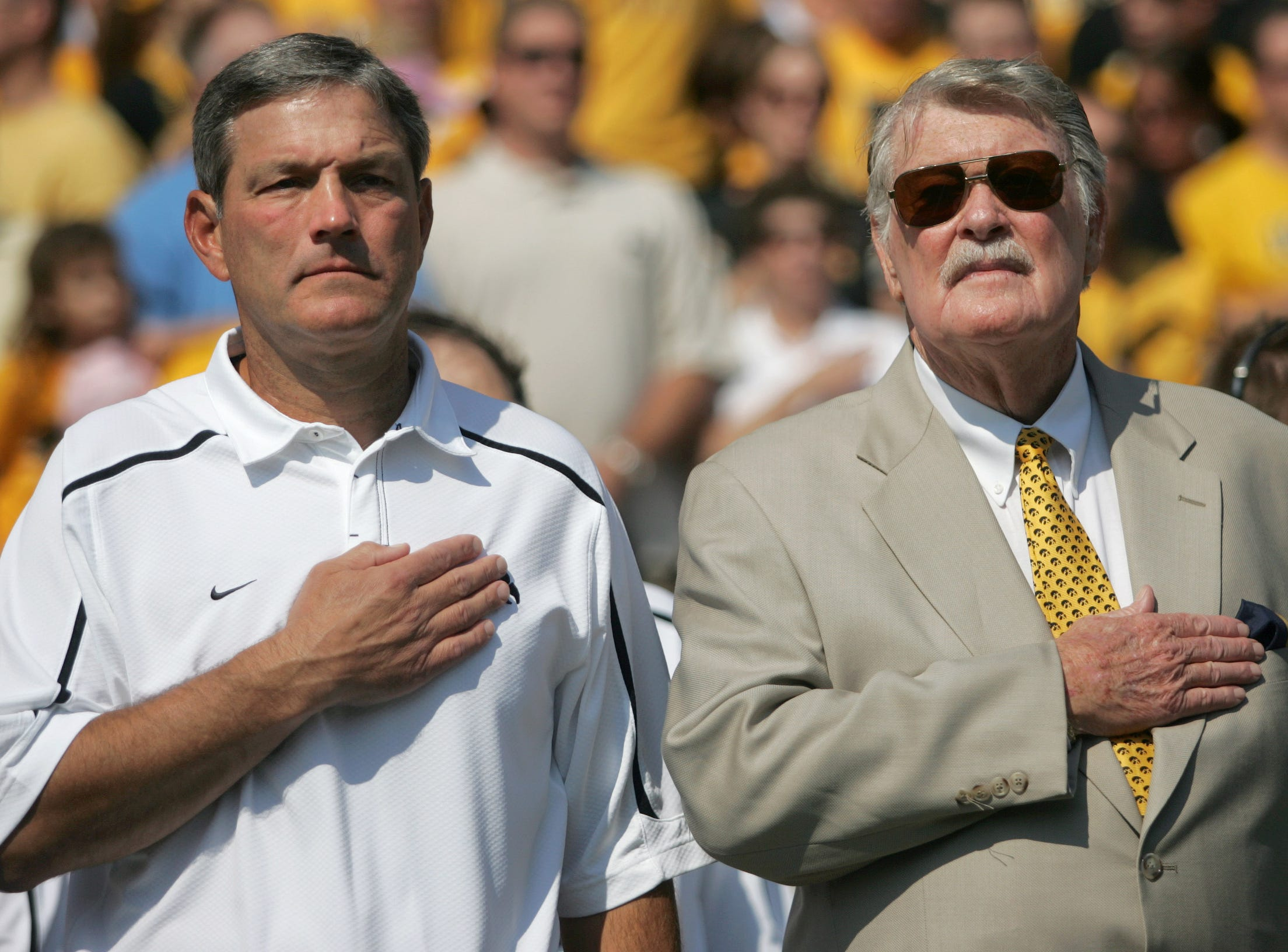 Iowa head coach Kirk Ferentz, left, and former Iowa coach Hayden Fry stand together during the National Anthem Sept. 5, 2009 in Iowa City.  Fry was an honorary team captain for the Hawkeyes' season opener.