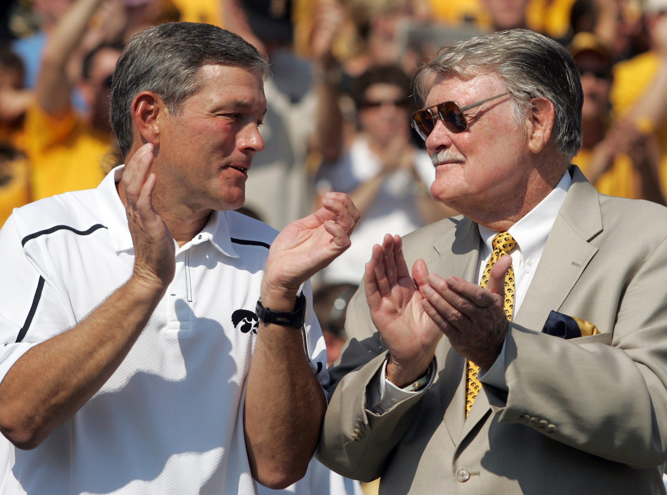 Iowa head coach Kirk Ferentz applauds with former Iowa coach Hayden Fry prior to kickoff Sept. 5, 2009 in Iowa City.  Fry was an honorary team captain for the season opener.