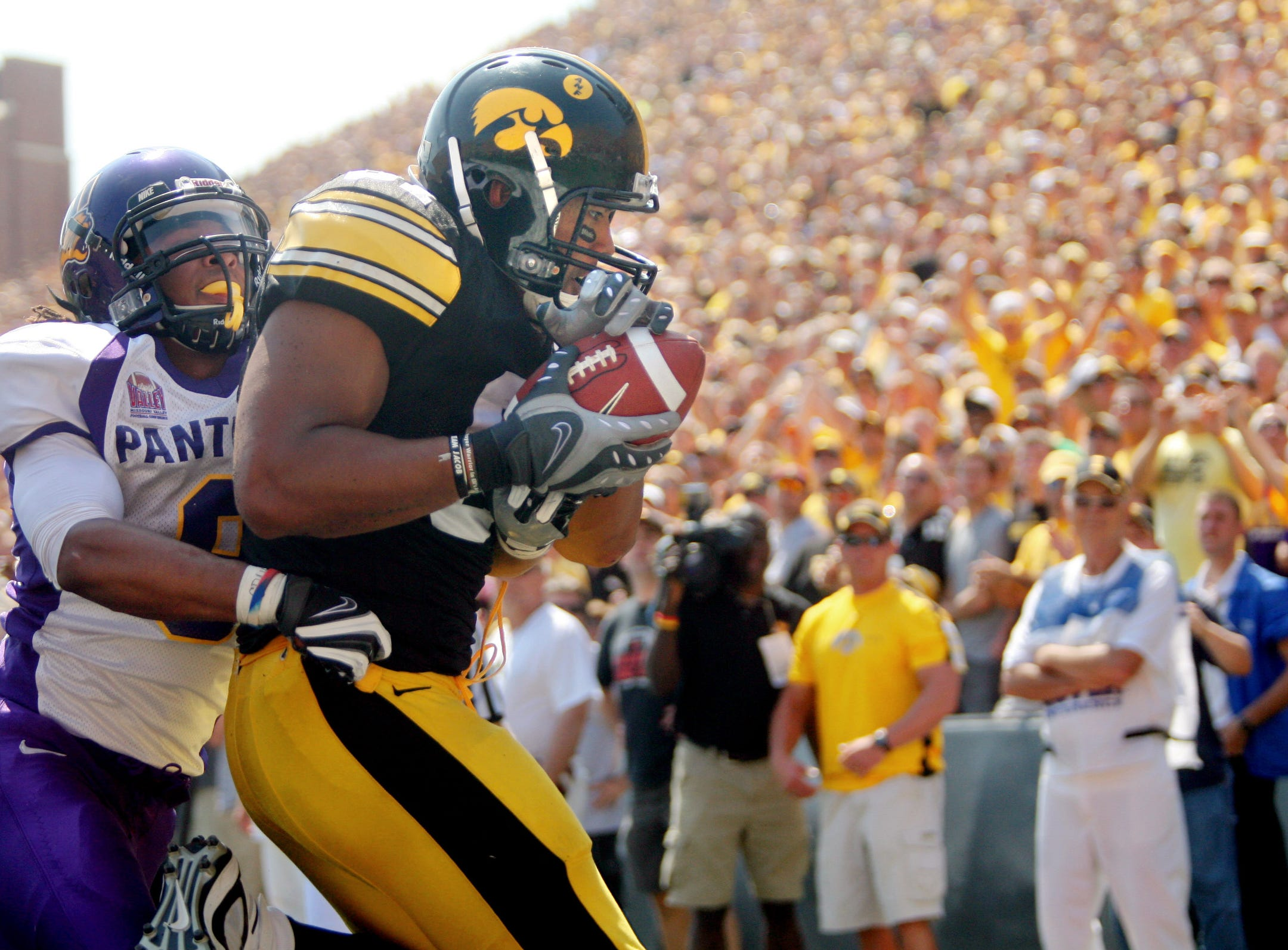 Iowa tight end Tony Moeaki (81) catches a fourth quarter touchdown pass over Northern Iowa cornerback Andre Martin (8) Sept. 5, 2009 in Iowa City.