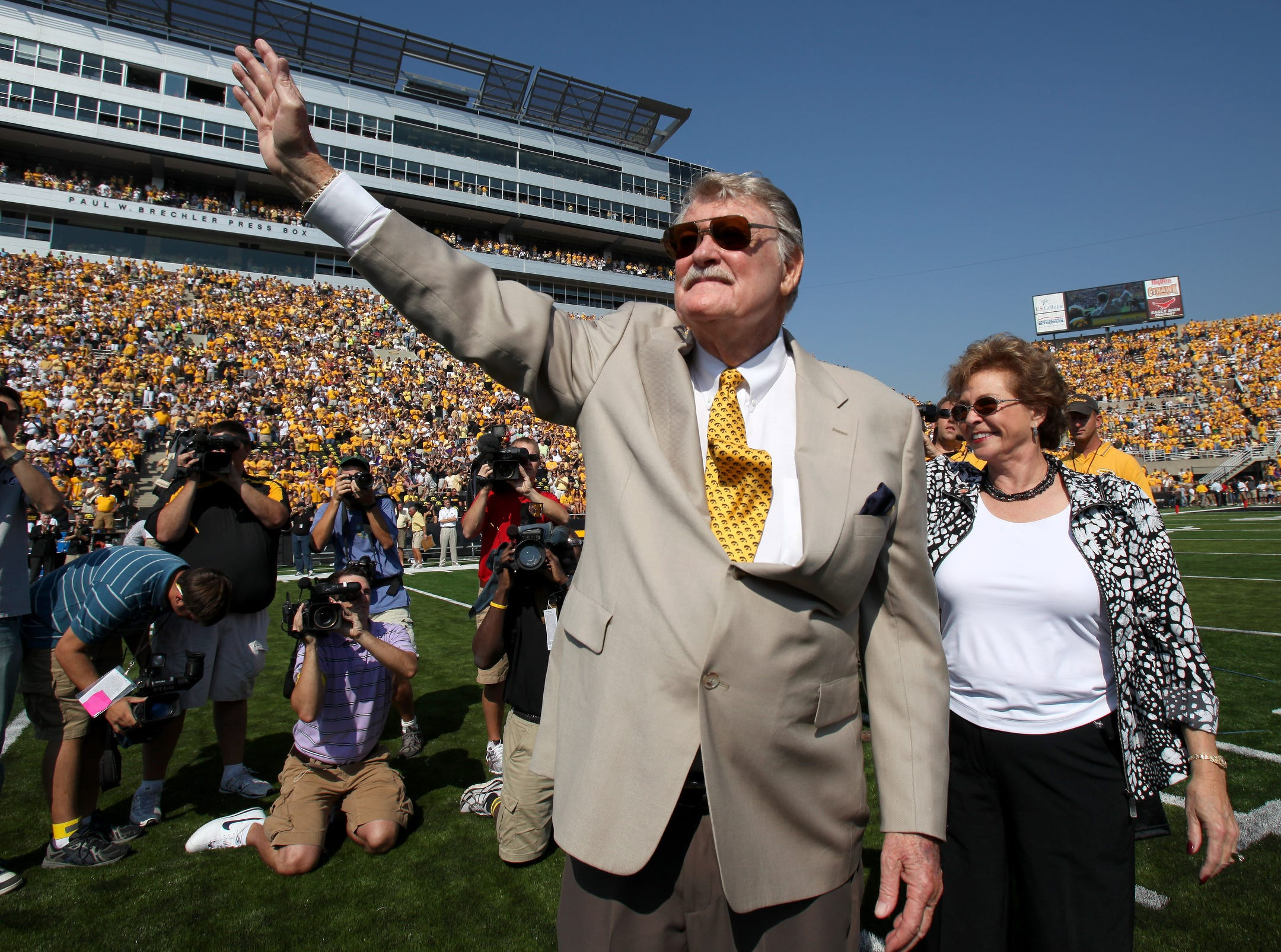 Former Iowa football coach Hayden Fry waves to the crowd with his wife, Shirley, at his side prior to kickoff Sept. 5, 2009 in Iowa City.