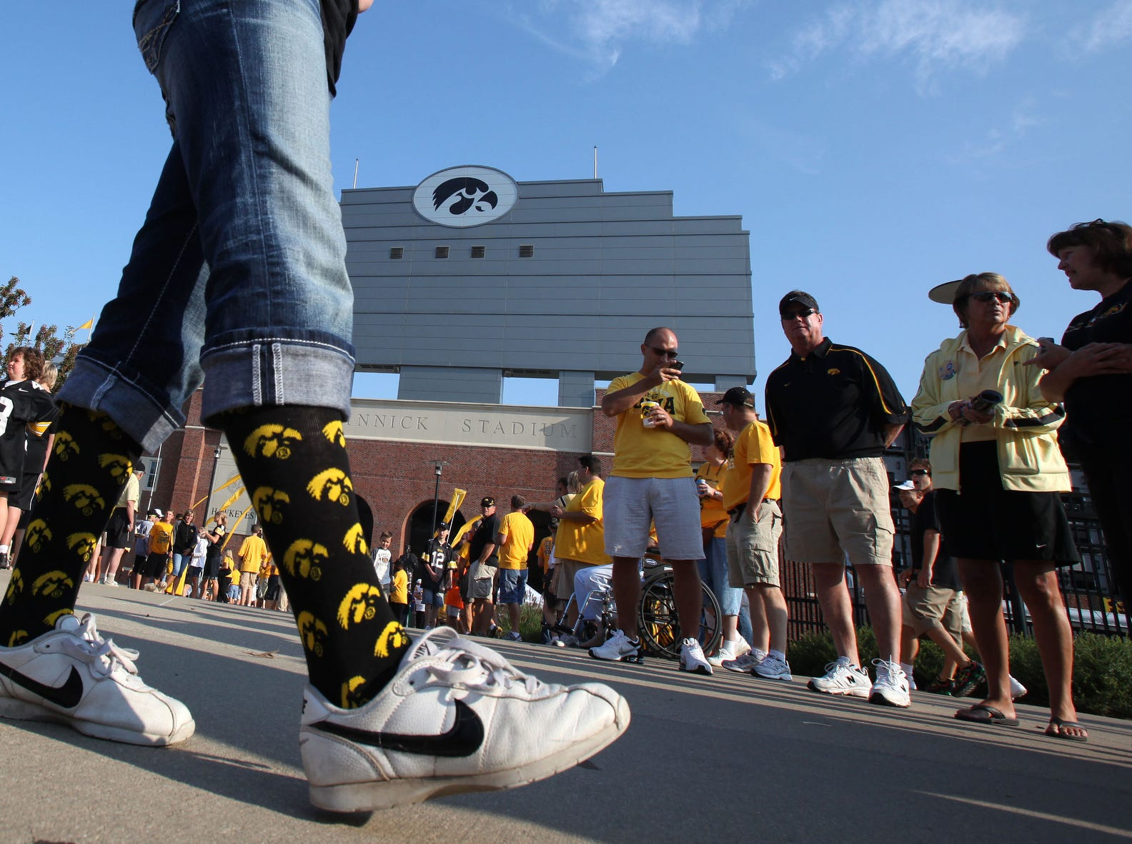 Abby Zaug, 16, of West Des Moines sports her school spirit on her socks outside Kinnick Stadium before Iowa's football season opener Sept. 5, 2009 against Northern Iowa.
