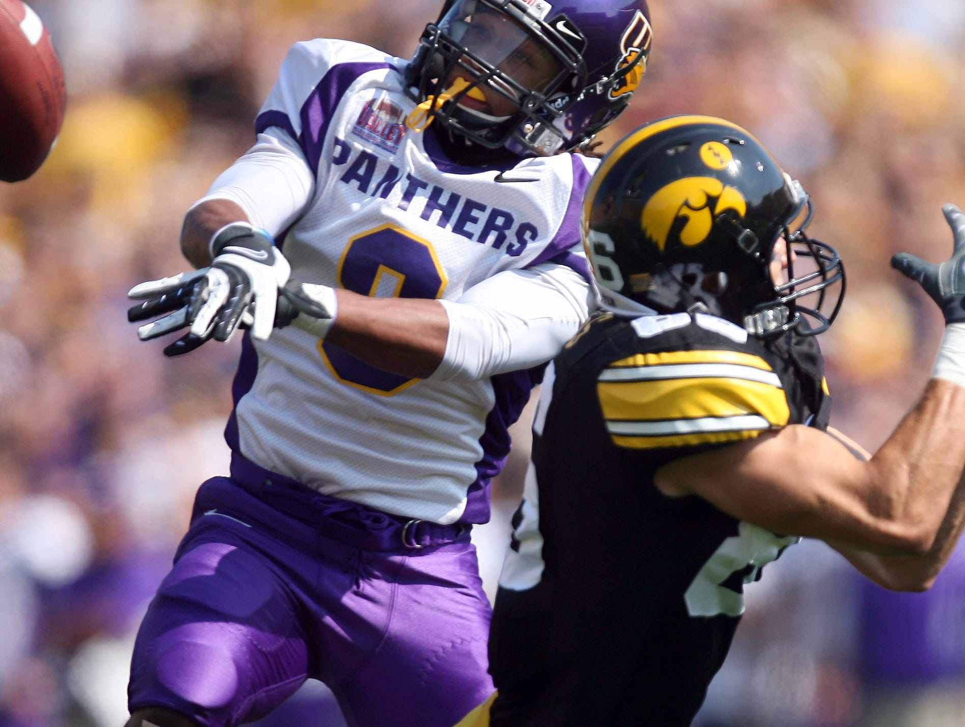 s0906iowafb - shot 09/04/09 Iowa City, IA.  Christopher Gannon/The Register  -- Iowa vs. Northern Iowa --   Northern Iowa cornerback Andre Martin (8) knocks a pass away from Iowa wide receiver Trey Stross (86) in the first quarter Saturday in Iowa City.  (Christopher Gannon/The Des Moines Register)