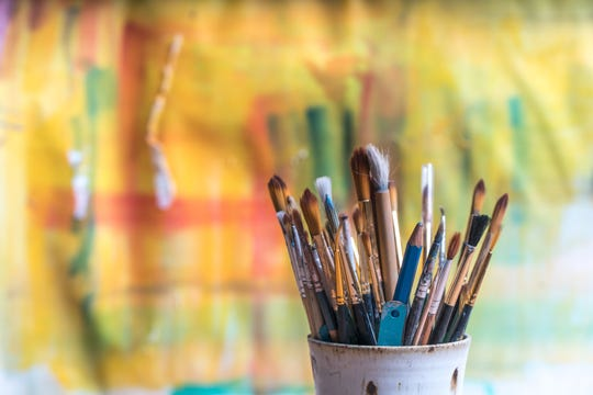 Paint brushes and canvas.