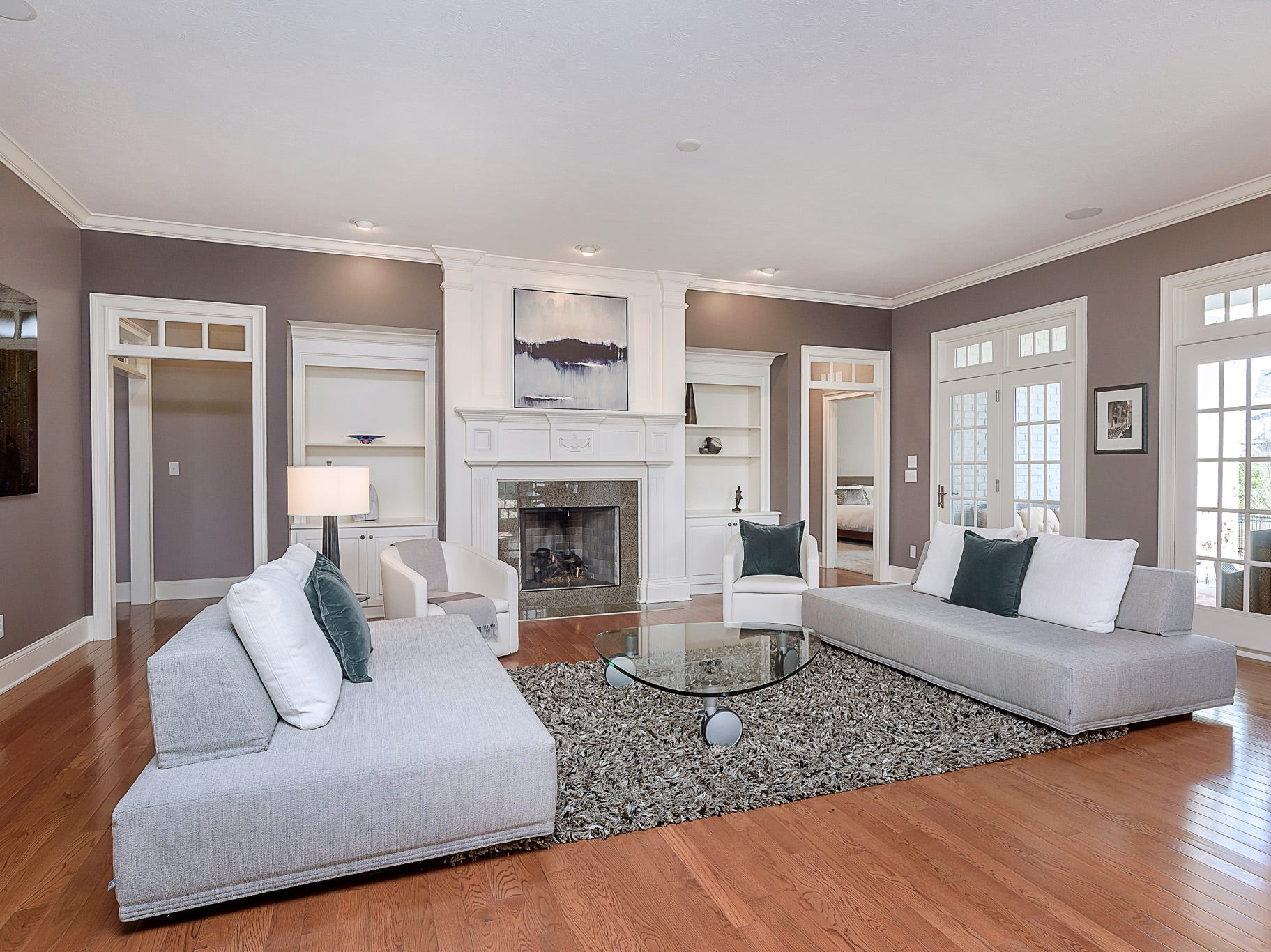 A view of the family room with access to patio. The home features an open concept floor plan.