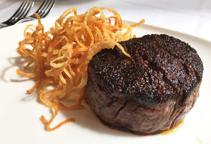 Seasoned salts and paprika are part of the secret seasoning blend that crusts the 12-ounce filet at Tony's Steaks & Seafood at the former Colts Grille, 110 W. Washington St., Downtown Indianapolis.
