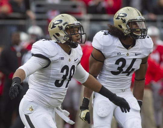 Purdue's Joe Gillia (39) and Max Charlot celebrated a penalty in the end zone against Ohio State that gave Purdue a safety Oct. 20, 2012, at Ohio Stadium in Columbus, Ohio. Purdue lost in overtime 29-22.