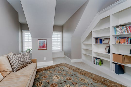 Additional room on the second floor, with views of the lake out front and built-in bookshelves.