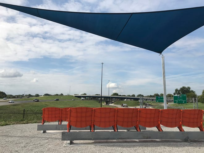 """""""The Idle: A Point of View"""" is a grassy public spot where visitors can watch highway traffic pass."""