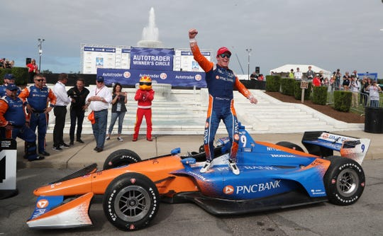 Scott Dixon celebrates on top of his car after winning the first race of the IndyCar Detroit Grand Prix auto racing doubleheader, June 2, 2018, in Detroit