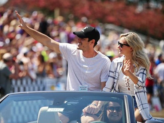 """""""The Bachelor"""" star Ben Higgins and ex-fiancee Lauren Bushnell at the 66th men's Little 500, at Indiana University on April 16, 2016."""