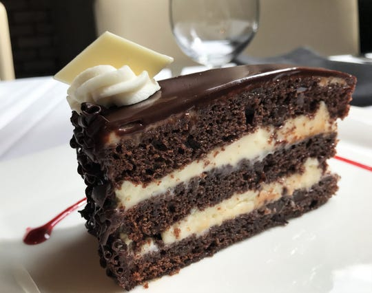 Chocolate Opera Cream Cake from The BonBonerie bakery in Cincinnati is served at every Tony's Steaks & Seafood restaurant. The brandy-soaked chocolate chip-studded cake layered with white chocolate cream and coated in silky coffee-spiked chocolate ganache  awaits a fork at Tony's of Indianapolis. The restaurant opened Sept.. 4, 2018, at the former Colts Grille, 110 W. Washington St., Downtown Indianapolis.
