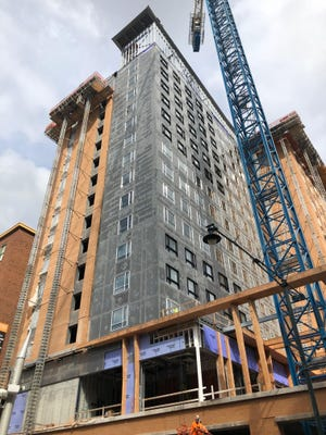 Construction on the 15-story dual Hyatt hotel across from Bankers Life Fieldhouse is almost complete.