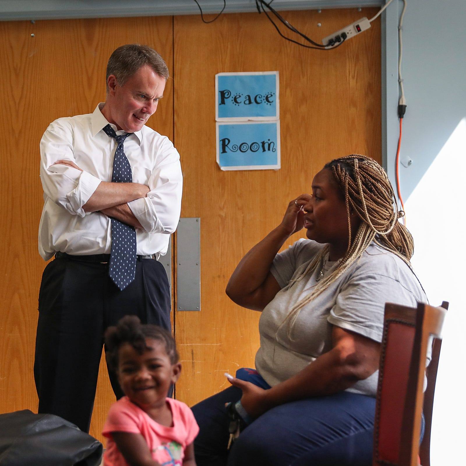 Indianapolis Mayor Joe Hogsett stops to chat with a familiar face, Monique Page, while touring the Martin Luther King Community Center in Indianapolis, Tuesday, Sept. 11, 2018.