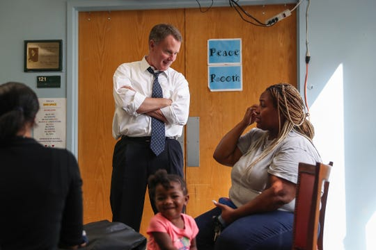 Indianapolis Mayor Joe Hogsett chats with Monique Page at the Martin Luther King Community Center on Sept. 11.