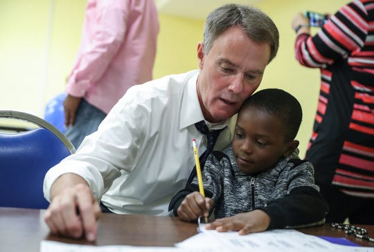 Mayor Hogsett helps Demerius Frierson, 6, with math homework at the Martin Luther King Community Center.