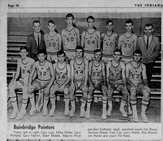 Fred Cox looms over teammates. He is third from the left in the back row of the Bainbridge Basketball team, which was later consolidated into North Putnam. Coach Pat Rady Sr. is in the back row, far right.