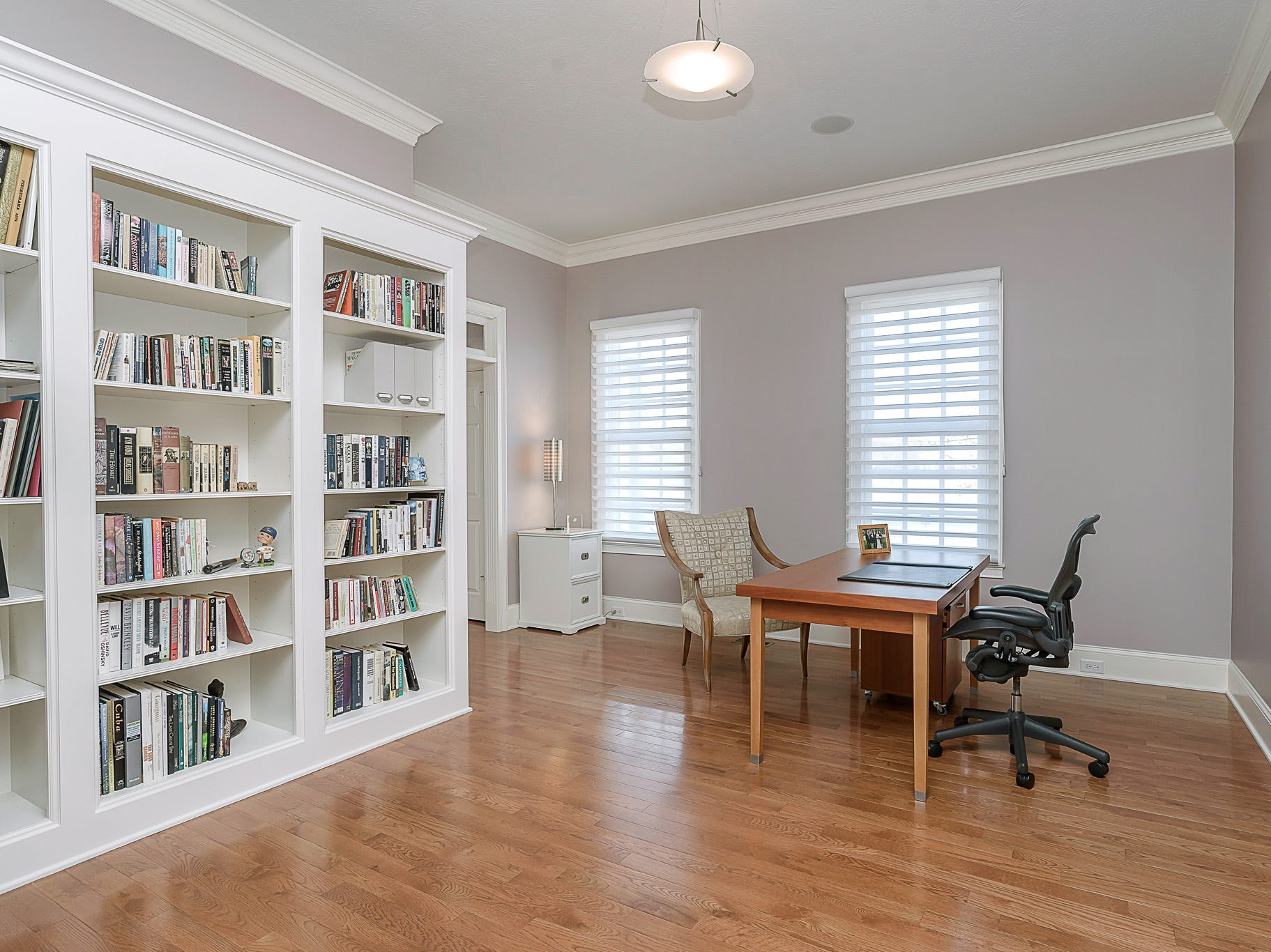 An office space on the main floor features built-in bookshelves.