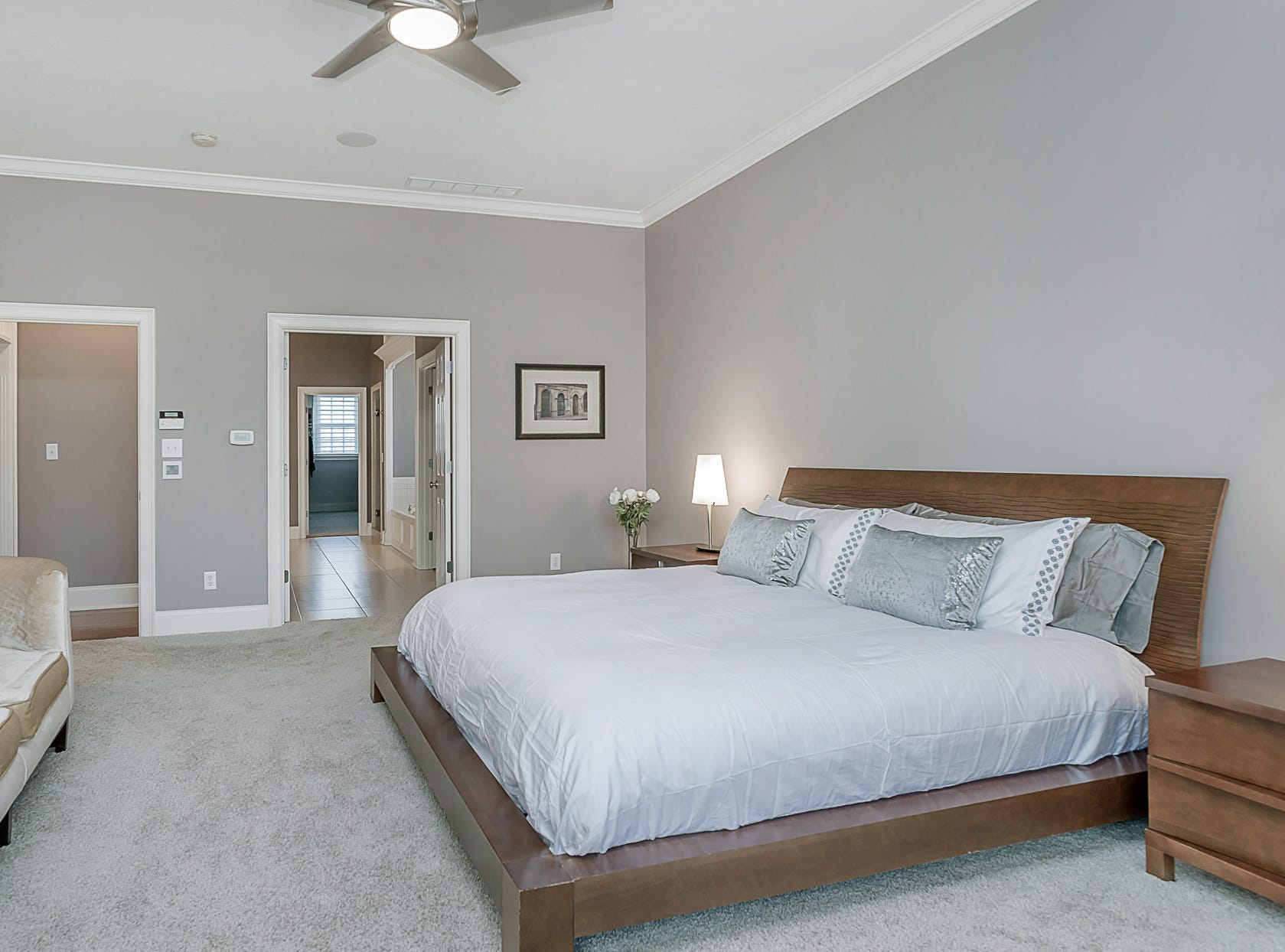 A view of the master bedroom on the main floor, which features a full bath and walk-in closet.
