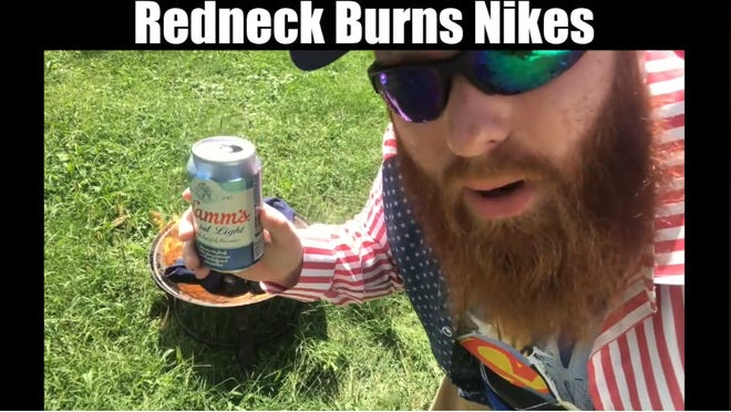 Brent Terhune burns his Nikes whilst drinking a Hamm's. Go Coats!