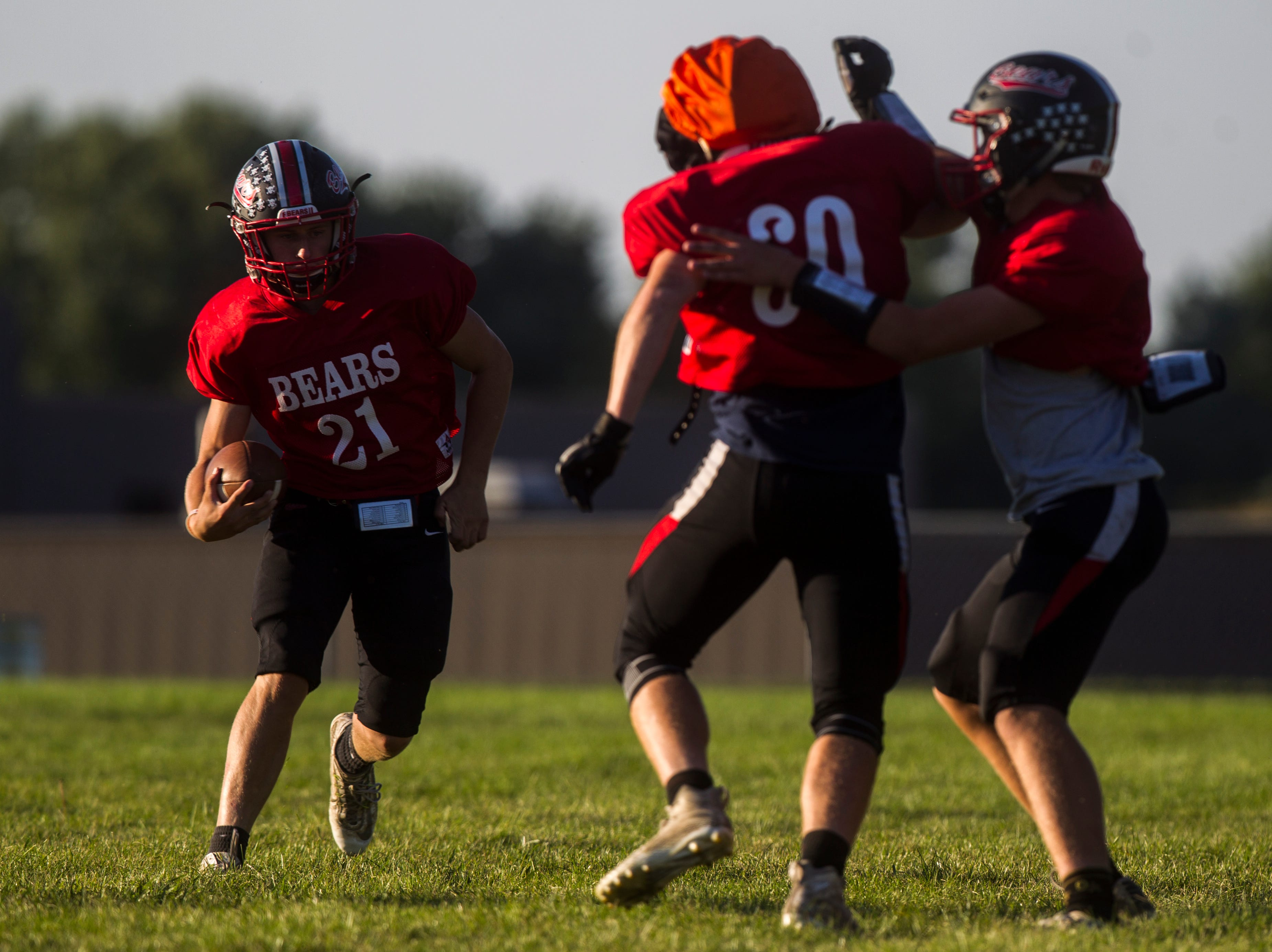 West Branch's Brett Schiele (21) jukes a defender during a varsity football practice on Tuesday, Sept. 11, 2018, at the West Branch High School practice field.