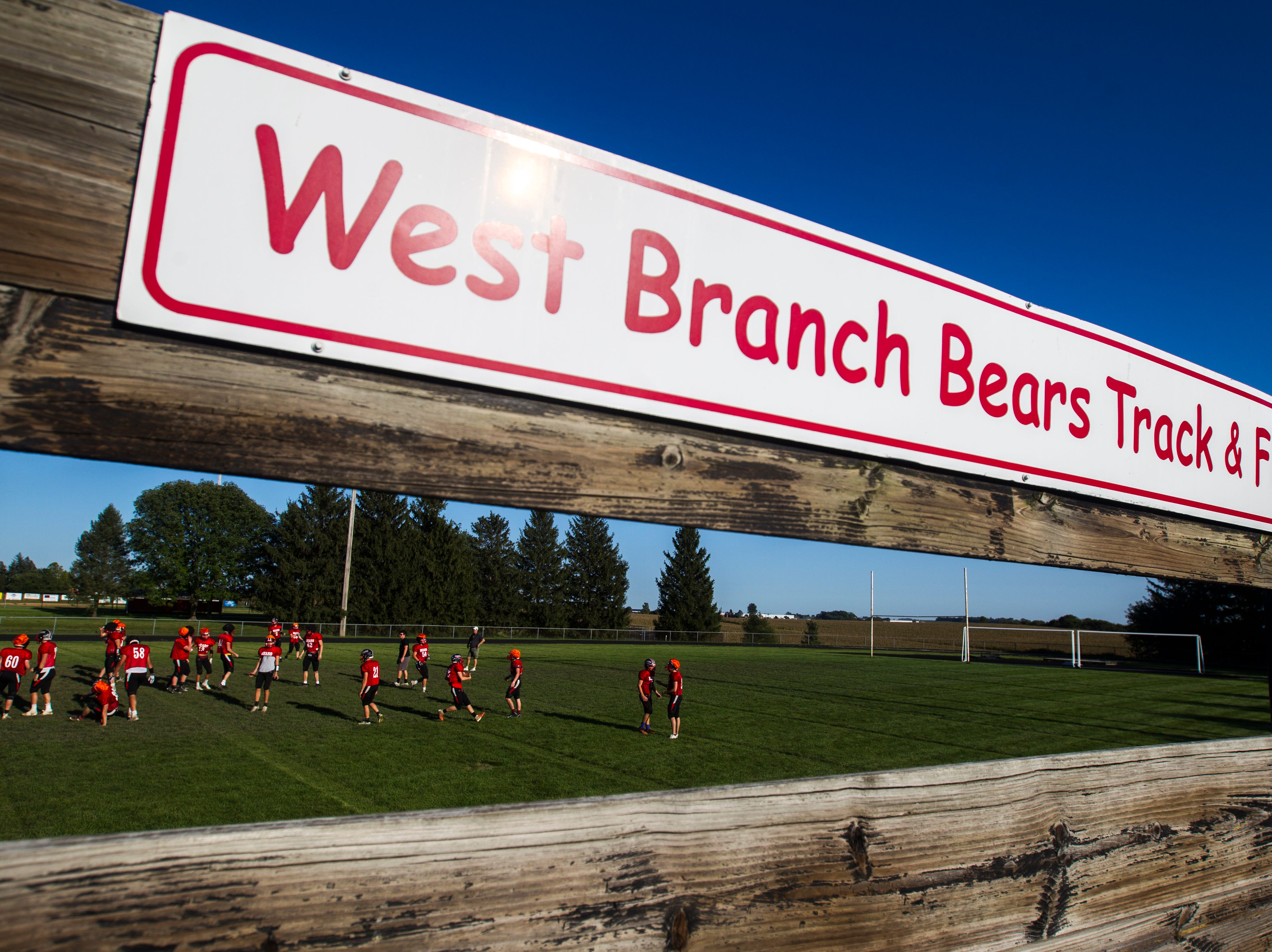 West Branch football players go through drills during a varsity football practice on Tuesday, Sept. 11, 2018, at the West Branch High School practice field.