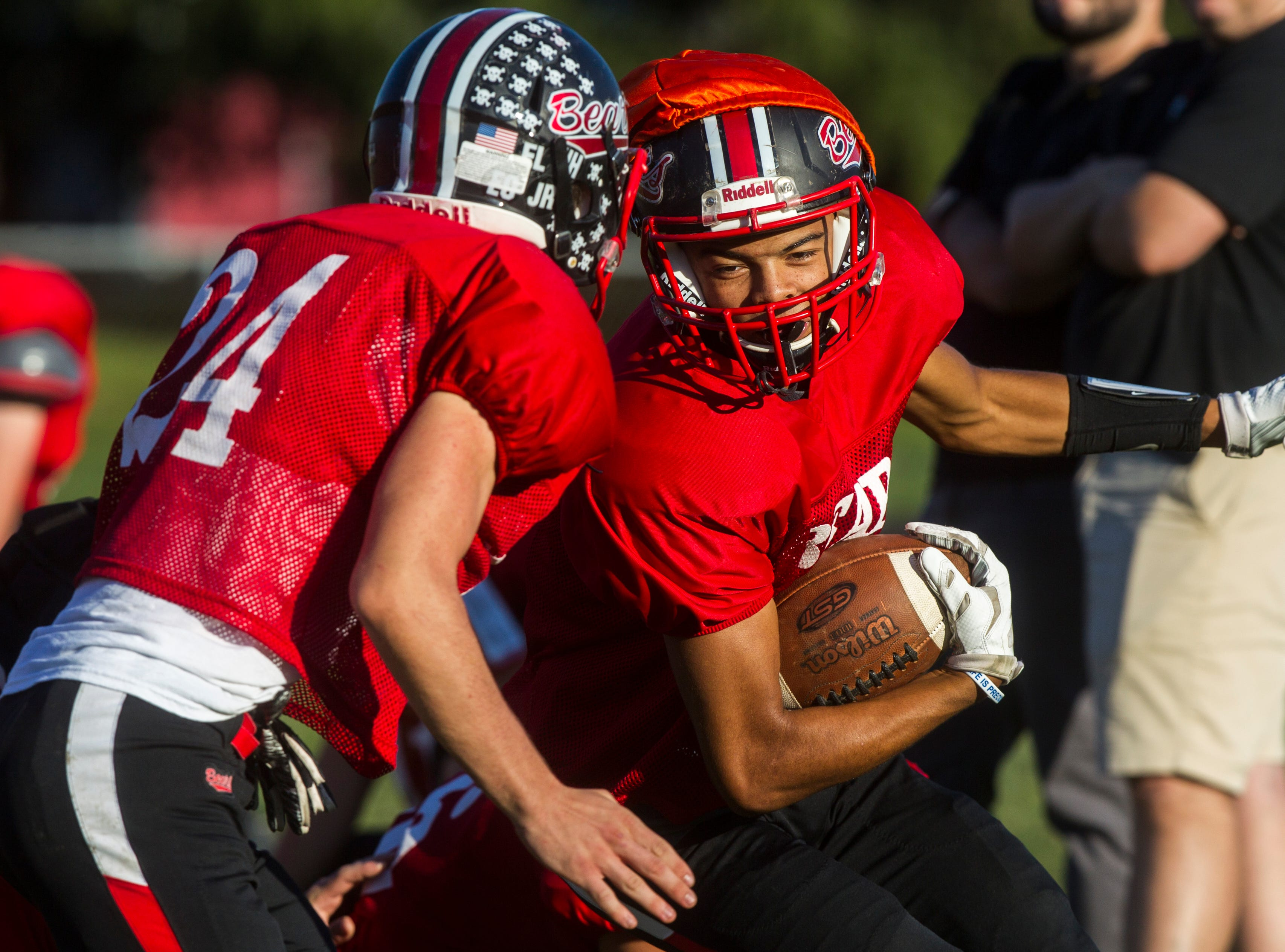 West Branch's Thomas Gould (6) gets tackled during a varsity football practice on Tuesday, Sept. 11, 2018, at the West Branch High School practice field.