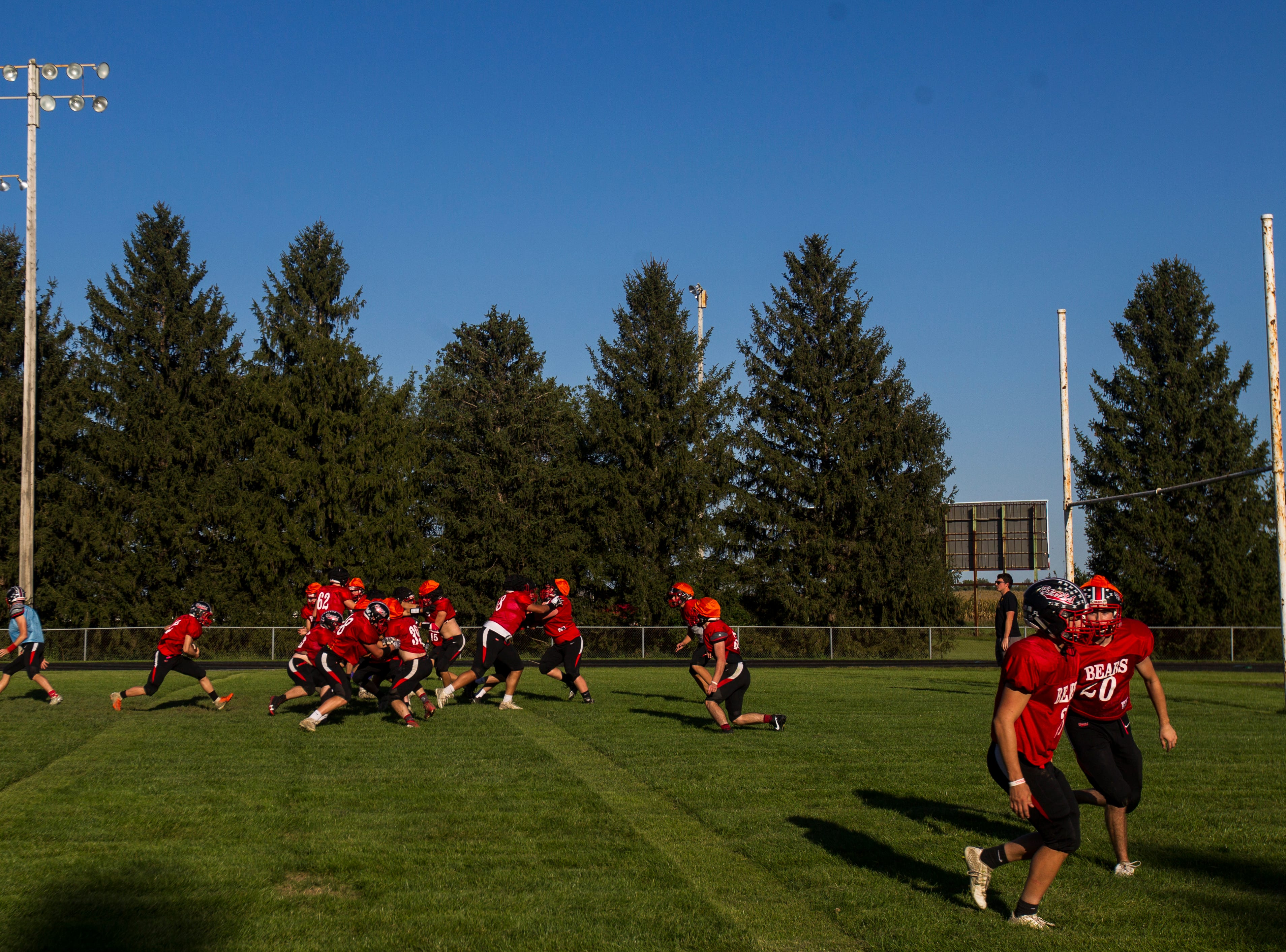 West Branch players run through drills during a varsity football practice on Tuesday, Sept. 11, 2018, at the West Branch High School practice field.