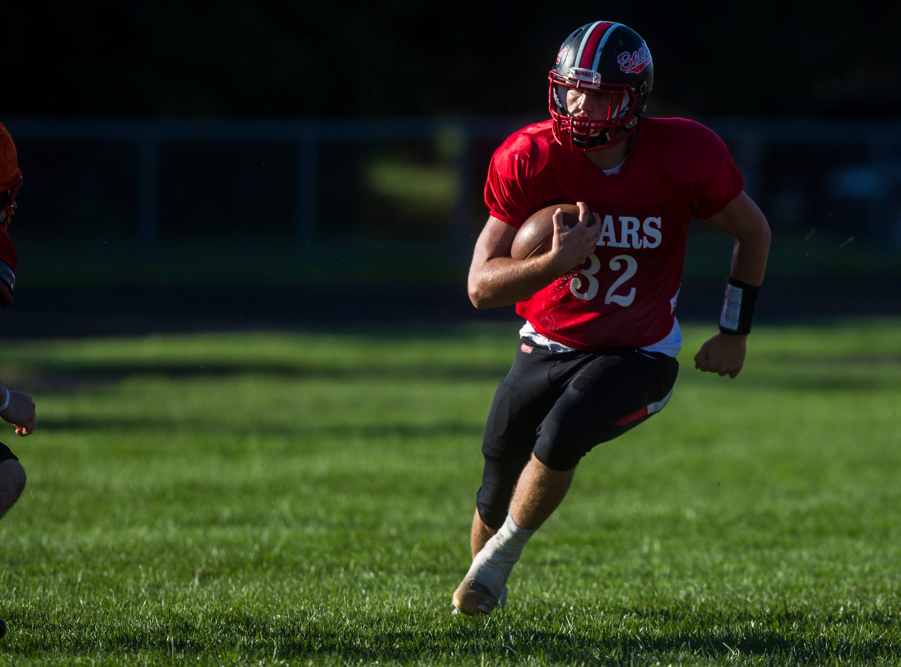 West Branch's Tanner Lukavsky runs with the ball during a varsity football practice on Tuesday, Sept. 11, 2018, at the West Branch High School practice field.