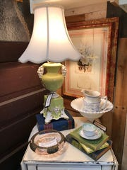 A lamp and other vintage items are among items for sale at The Storehouse at Repeat Street.