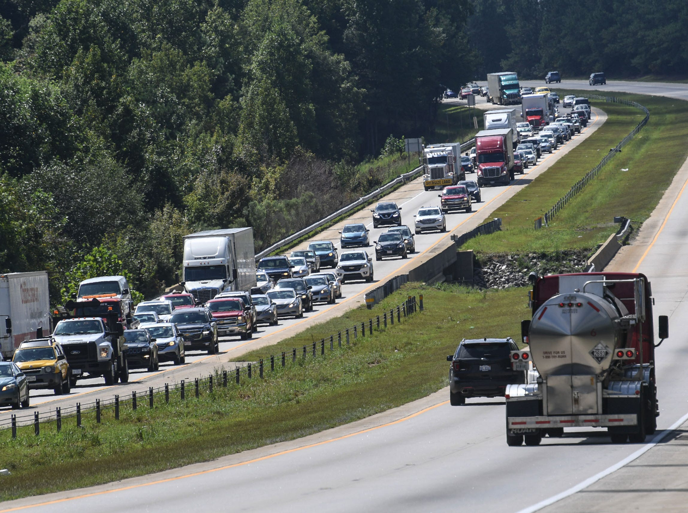 Sep 11, 2018; Wilmington, NC, USA; Cars drive slowly away from the coast on I-40 in Garner, N.C. on Tuesday, September 11, 2018. Hurricane Florence is expected to arrive in Wilmington, North Carolina late Thursday night through Friday morning.