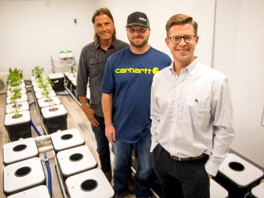 Joe Fox, right, Erich Maelzer, center, and Matthew DeBardelaben, left, work at Blühen Botanicals, which will begin production at the end of the year.