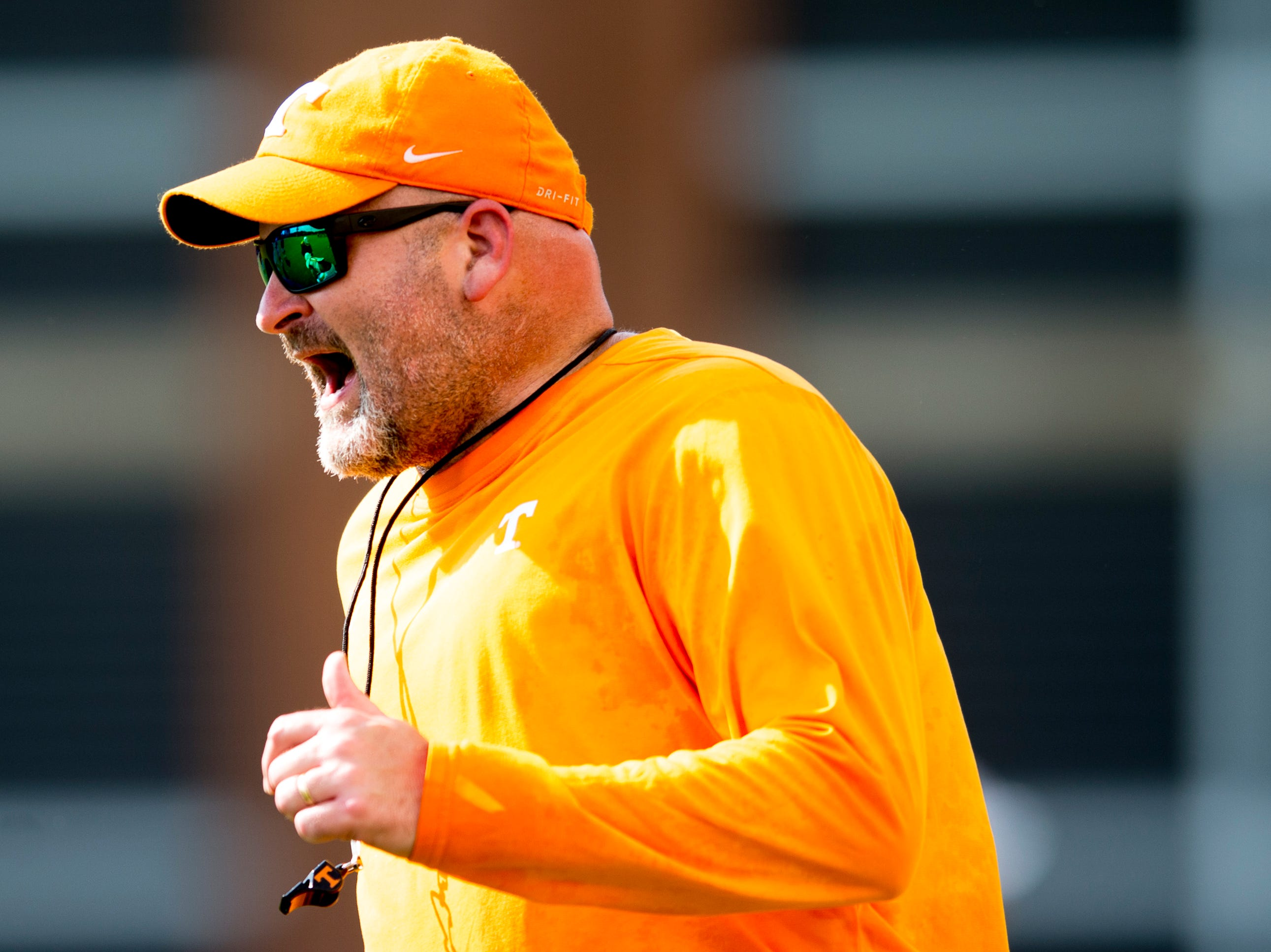 Offensive Line Coach Will Friend calls during Tennessee fall football practice at Haslam Field in Knoxville, Tennessee on Wednesday, September 12, 2018.
