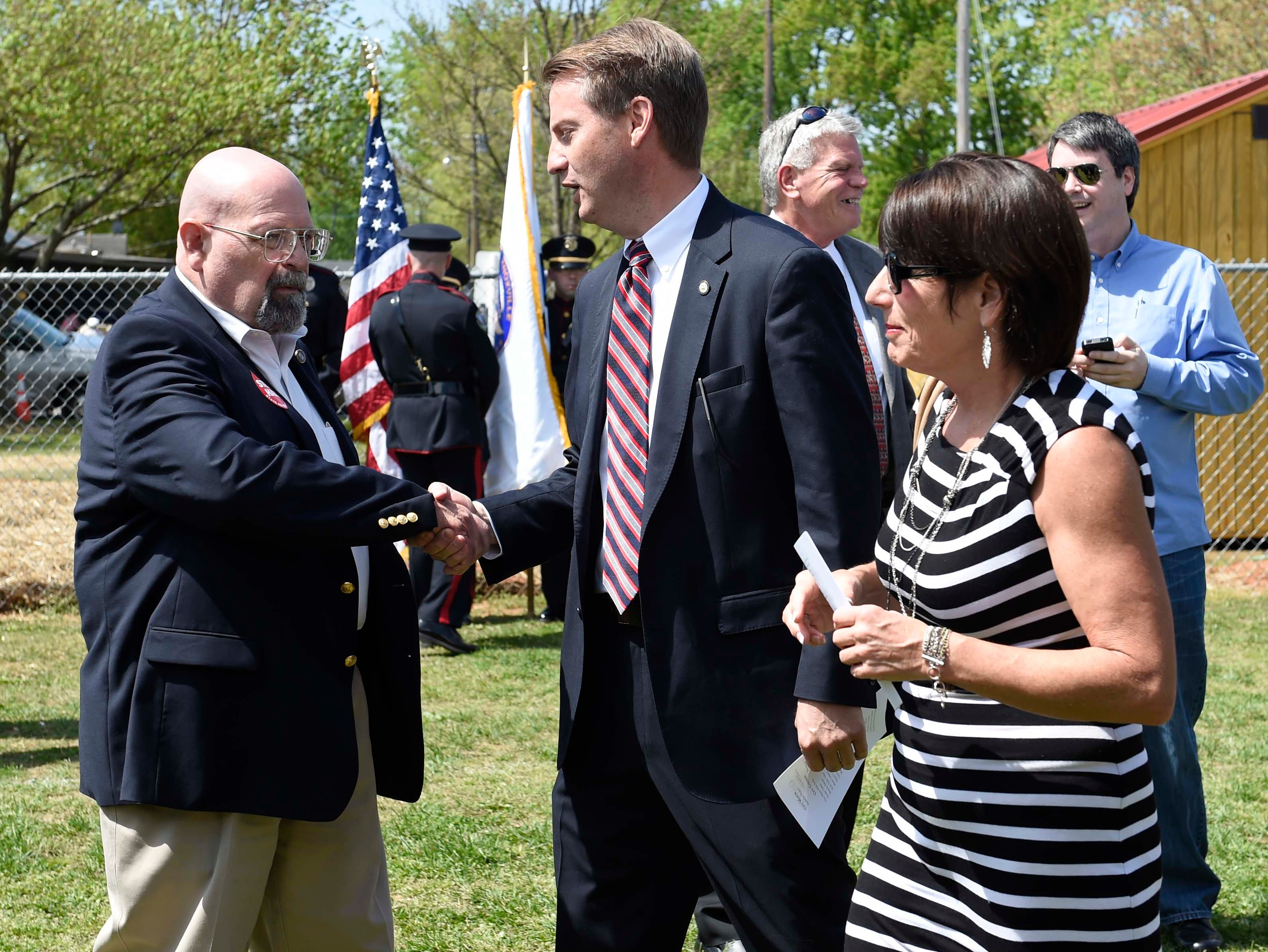 Rep. Steve Hall greets Knox County mayor Tim Burchett and Carol Evans with Legacy Parks Foundation before the City of Knoxville 2014 budget address at Christenberry Ball Park, Thursday, April 24, 2014. The mayor proposed a 34 cent property tax increase as part of the new budget.