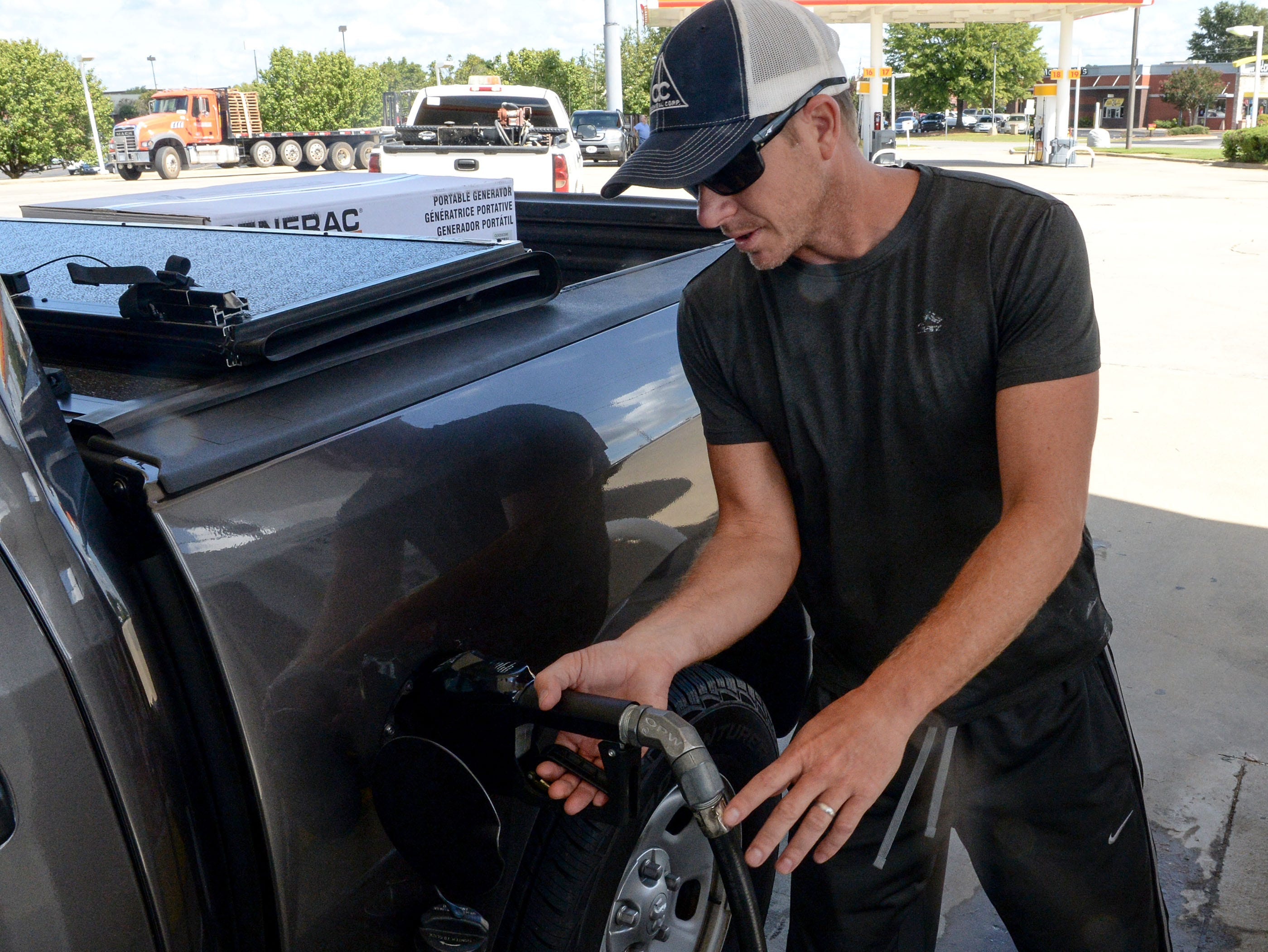 Sep 11, 2018; Wilmington, NC, USA; Chad Williams of Willow Springs, North Carolina, fills his gas tank up in Garner, N.C. on Tuesday, September 11, 2018. Williams also bought a generator as Hurricane Florence is expected to arrive in Wilmington, North Carolina late Thursday night through Friday morning.