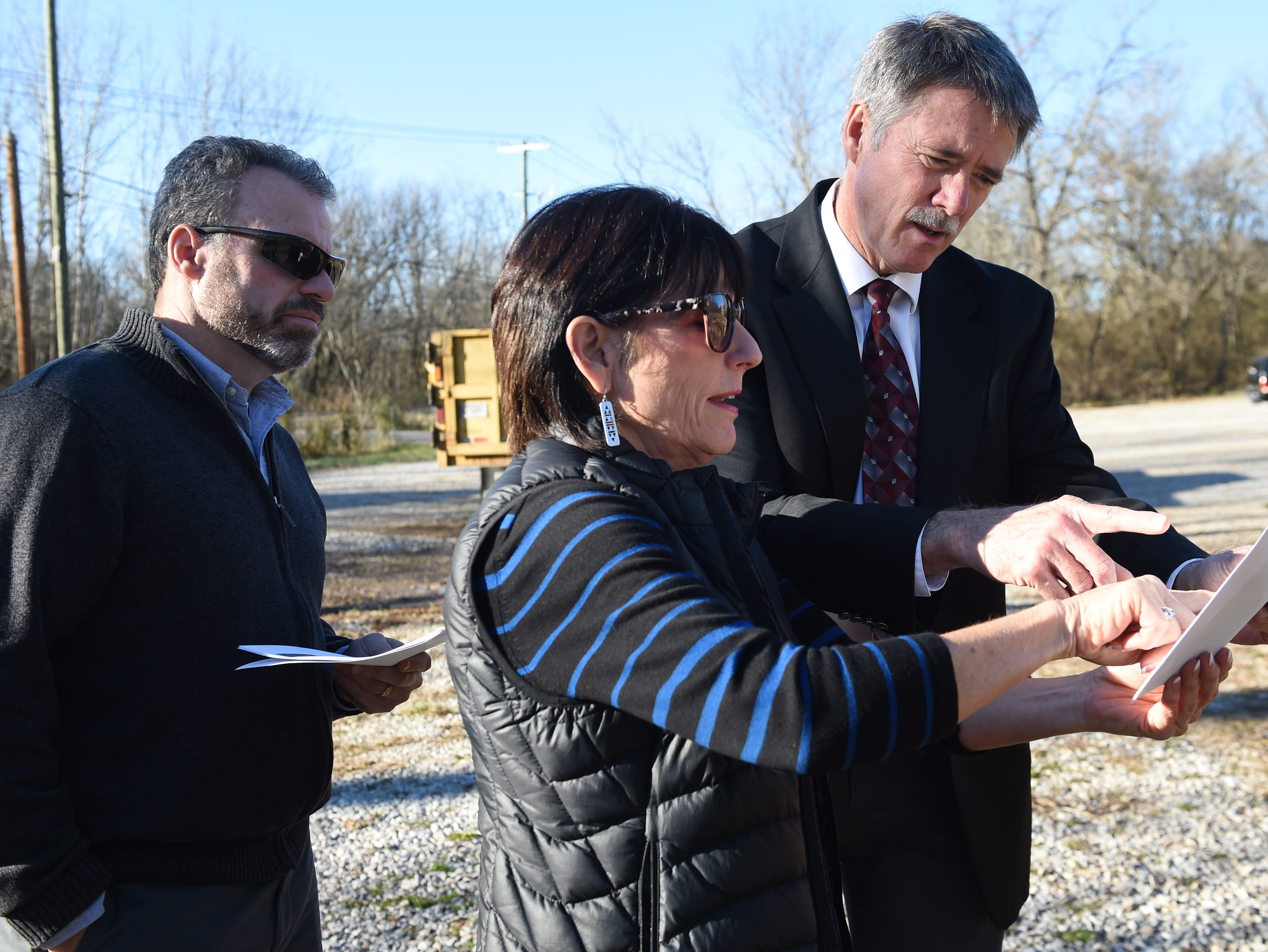 Legacy Parks Executive Director Carol Evans, center,  shows board members Doug Bataille, left, Senior Director, Knox County Parks & Recreation, and Joe Walsh, Director of Parks & Recreation, City of Knoxville, around the Wood property at 1516 Taylor Rd., where six miles of new trails with be constructed, Thursday, Jan. 14, 2016.