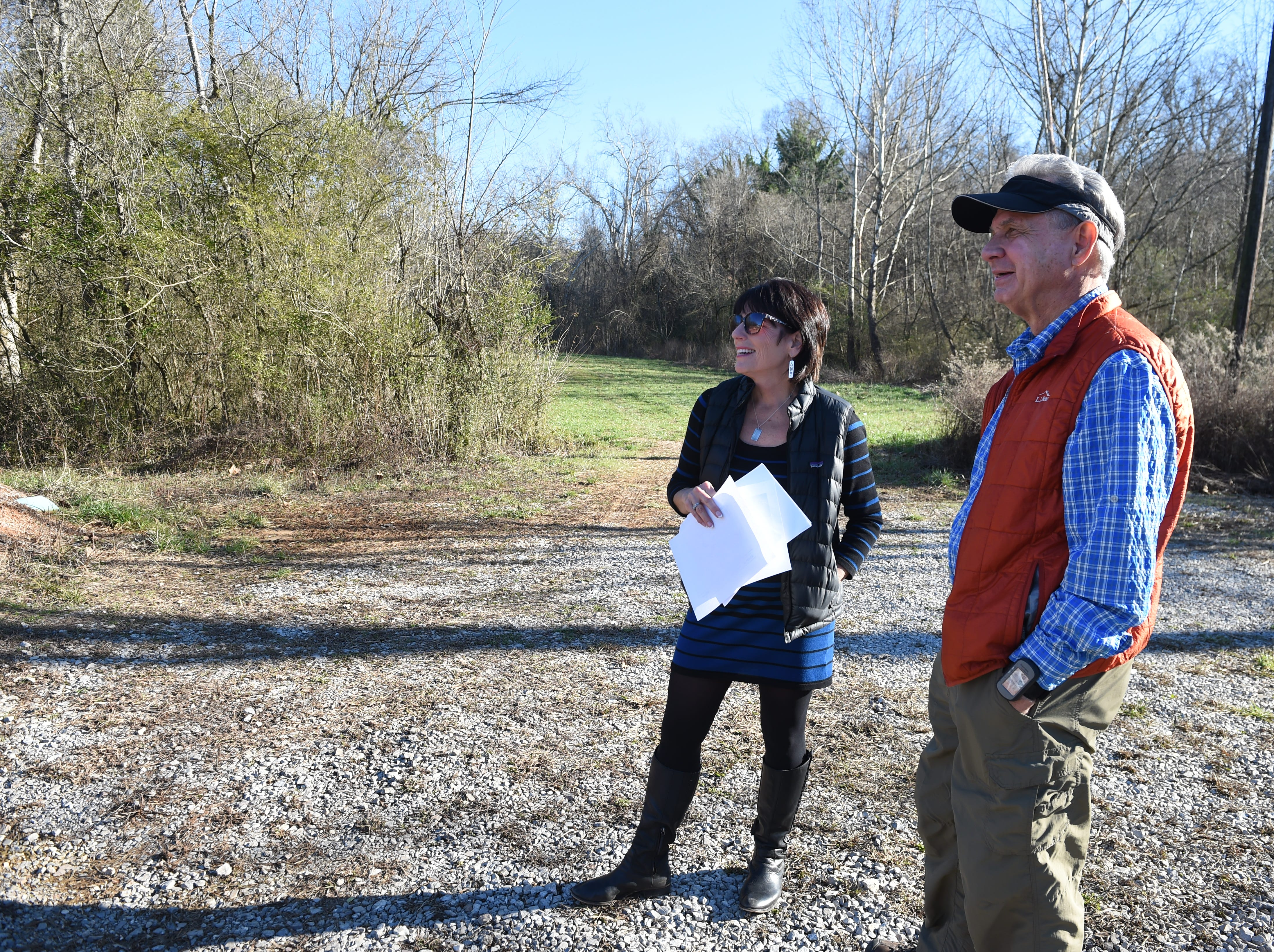 Legacy Parks Executive Director Carol Evans, left, shows board member Will Skelton around the Wood property at 1516 Taylor Rd., where six miles of new trails with be constructed, Thursday, Jan. 14, 2016. The Legacy Parks Foundation celebrated its 10th year anniversary in 2015 with a long list of achievements aimed at preserving land - and water - for public access. Since its origin, Legacy Parks has conserved more than 1,000 acres of forest and farmland and added nearly 500 acres of parkland in and around Knoxville.