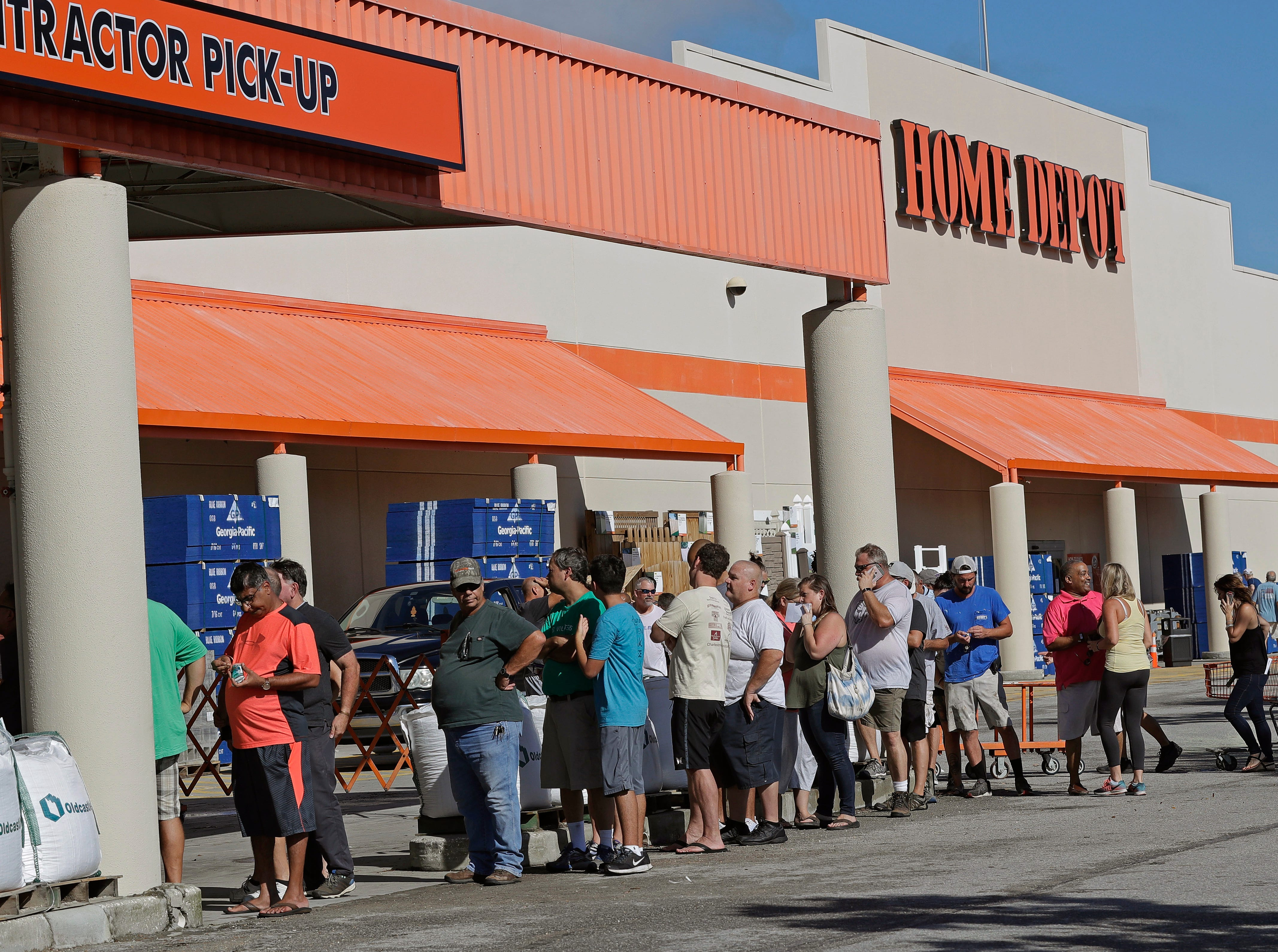 People line up outside a Home Depot for a new supply of generators and plywood in advance of Hurricane Florence in Wilmington, N.C., Wednesday, Sept. 12, 2018. Florence exploded into a potentially catastrophic hurricane Monday as it closed in on North and South Carolina, carrying winds up to 140 mph (220 kph) and water that could wreak havoc over a wide stretch of the eastern United States later this week.