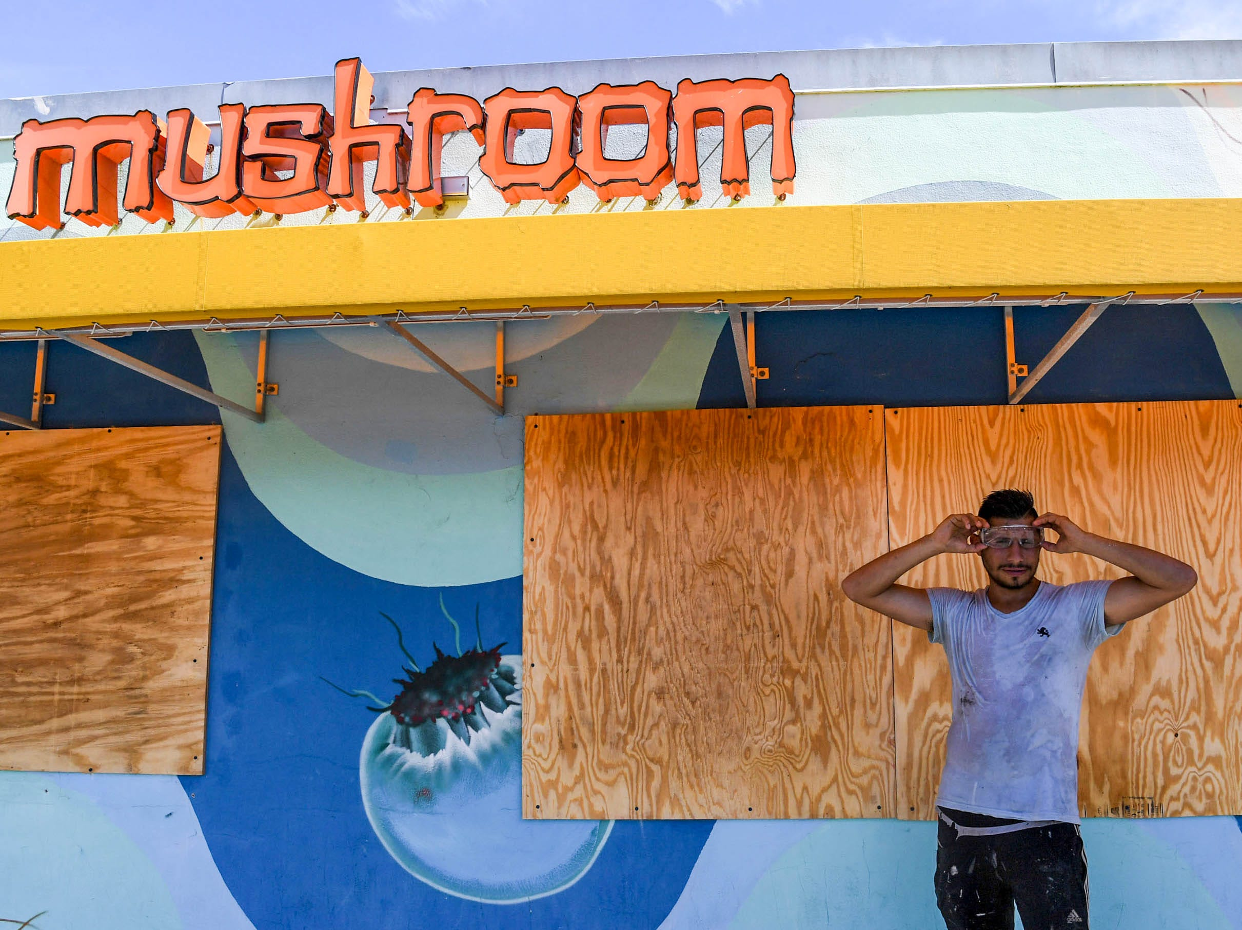 Sep 11, 2018; Wilmington, NC, USA; Ricardo Olivares, of Wilmington, North Carolina, covers windows at the Mellow Mushroom in Wilmington, North Carolina on Tuesday, September 11, 2018. Olivares said he is evacuating before Hurricane Florence arrives in Wilmington, North Carolina late Thursday night through Friday morning.